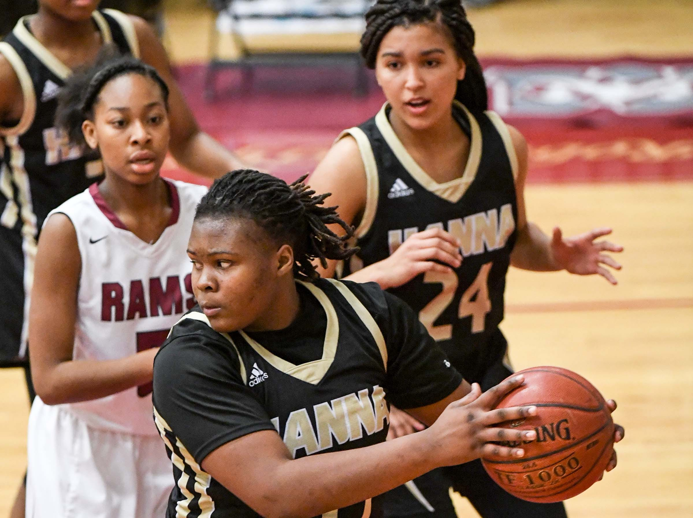 TL Hanna freshman Dro Lee(33) rebounds near Westside senior Chelsea Adger(5) during the first quarter at Westside High School in Anderson on Friday.