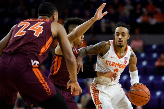 Clemson guard Marcquise Reed (2) attempts at advance past Virginia TechÕs Wabissa Bede (3) and Kerry Blackshear Jr. (24) at Littlejohn Coliseum on Saturday, Feb. 9, 2019.