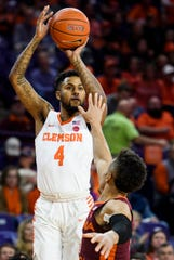 Clemson guard Shelton Mitchell (4) attempts to shoot the ball as Virginia TechÕs Wabissa Bede (3) defends at Littlejohn Coliseum on Saturday, Feb. 9, 2019.