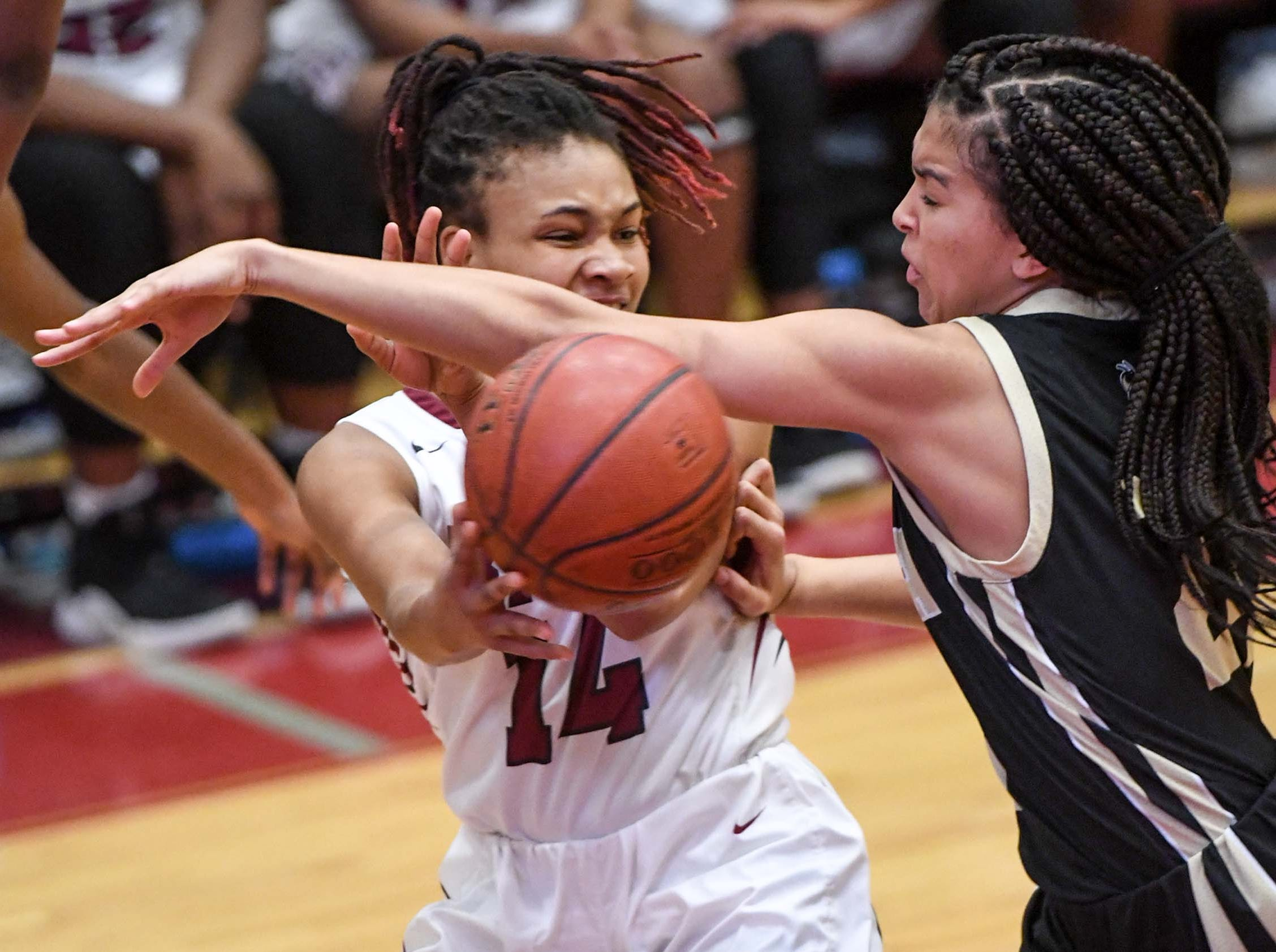 Westside junior Tatyana Lewis(14) passes around the defense of TL Hanna junior Maleia Bracone(24) during the fourth quarter at Westside High School in Anderson on Friday. Westside won 54-46.