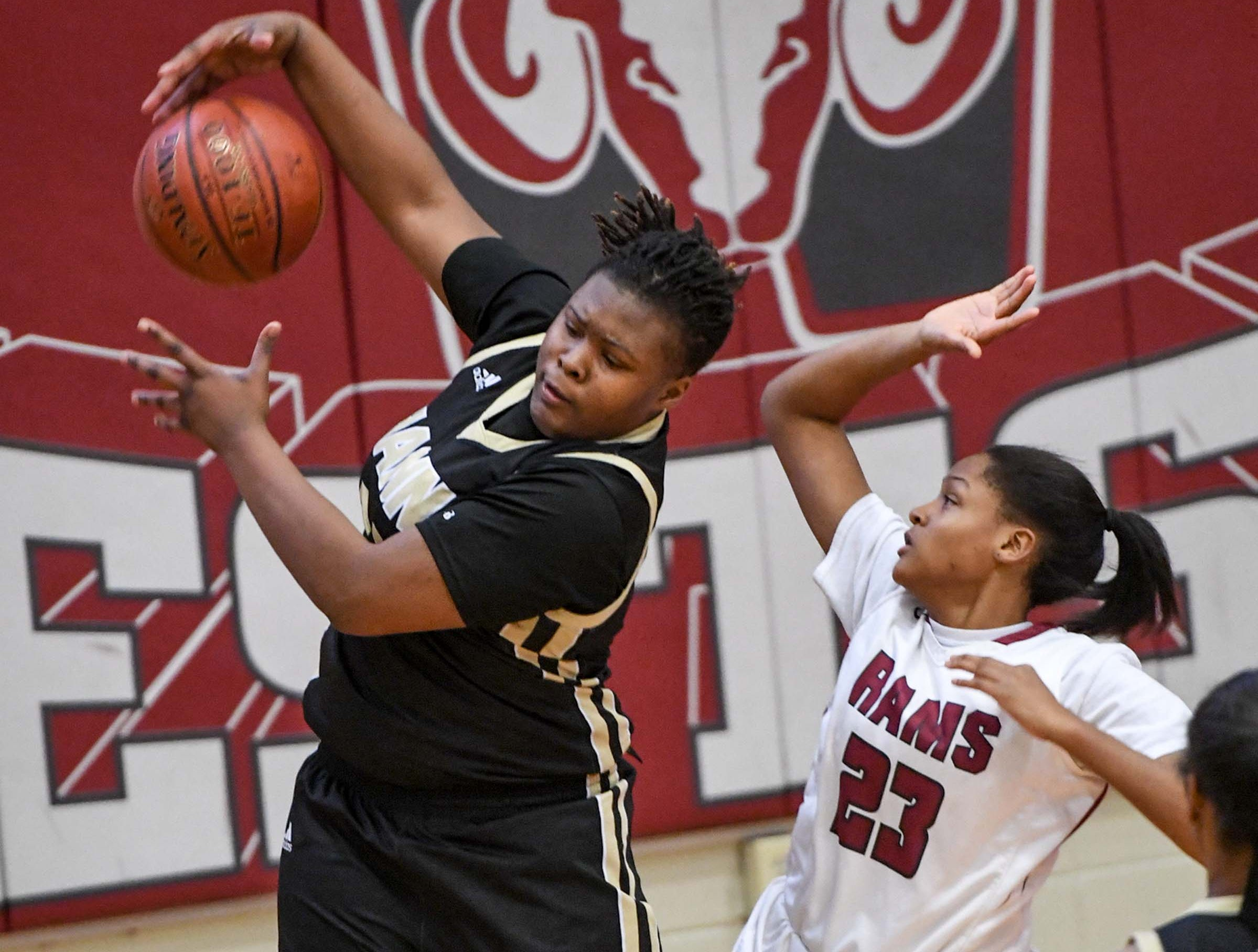 TL Hanna freshman Dro Lee(33) rebounds near Westside freshman Keazia Hatten(23) during the first quarter at Westside High School in Anderson on Friday.