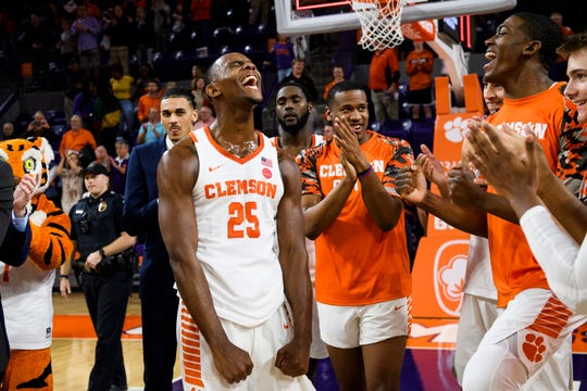 Clemson forward Aamir Simms (25) celebrates with his teammates after beating Virginia Tech 59-51 at Littlejohn Coliseum on Saturday, Feb. 9, 2019.