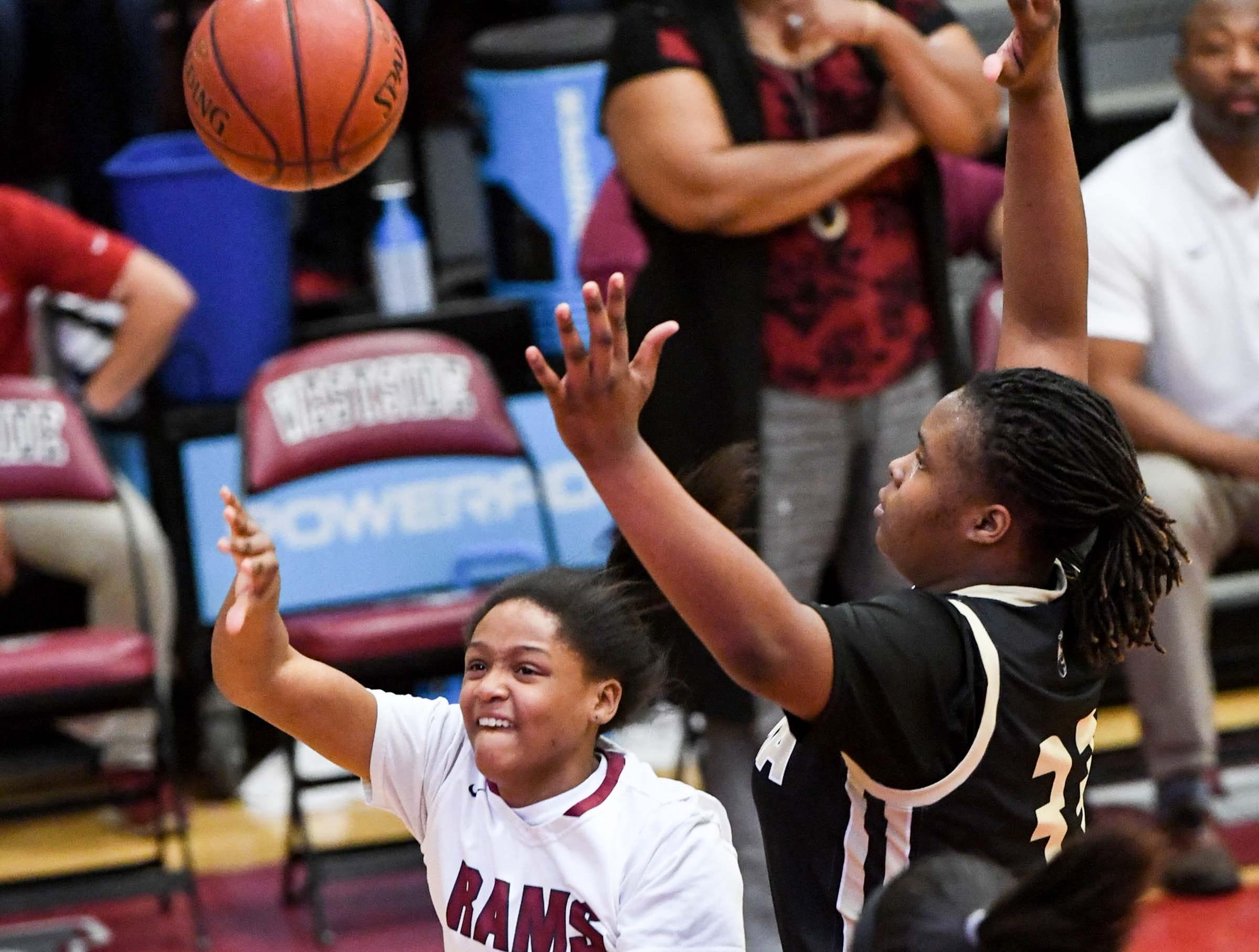 Westside freshman Keazia Hatten(23) shoots near TL Hanna freshman Dro Lee(33) during the fourth quarter at Westside High School in Anderson on Friday. Westside won 54-46.