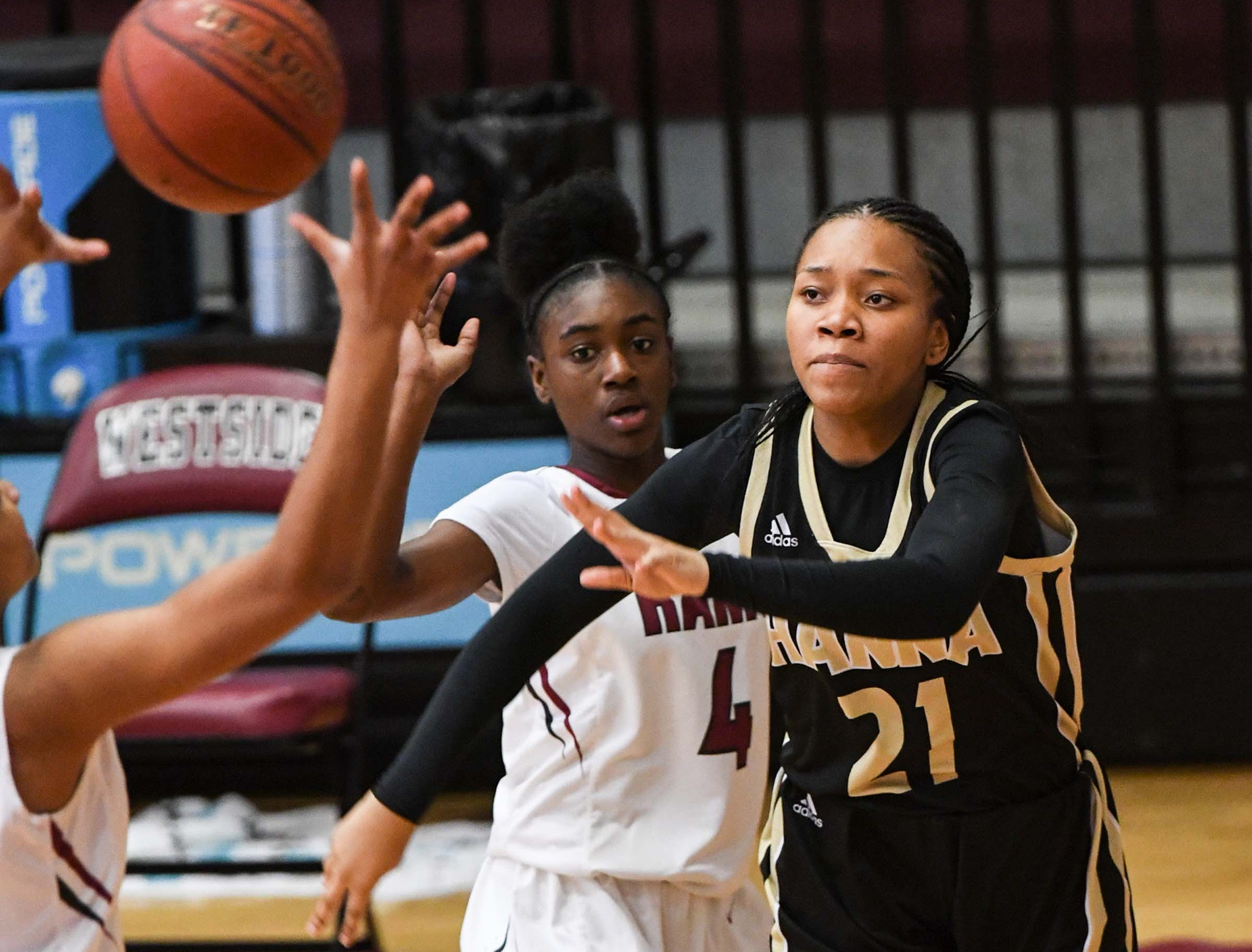 TL Hanna junior Azariah Thomas(21) near Westside freshman Aziyah Bell(4) during the first quarter at Westside High School in Anderson on Friday.