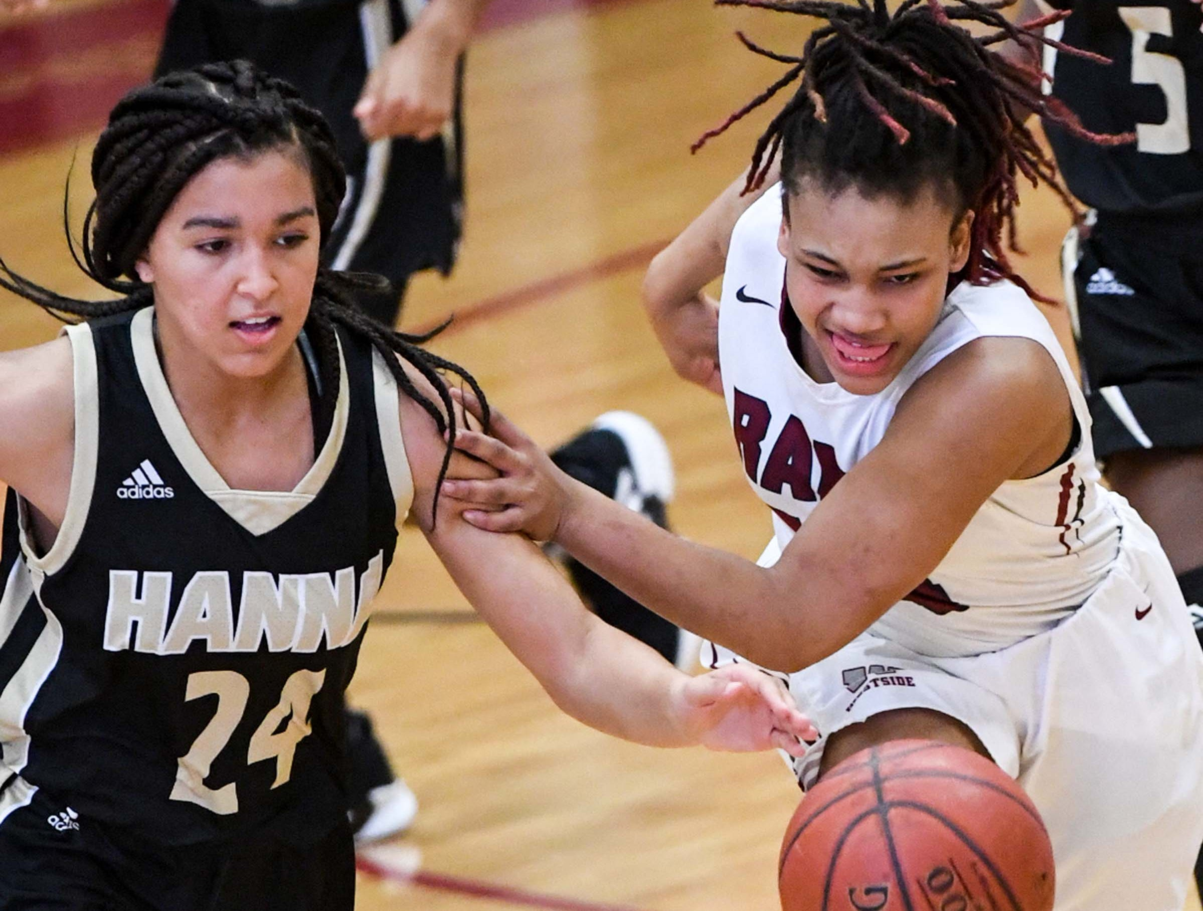 TL Hanna junior Maleia Bracone(24) and Westside junior Tatyana Lewis(14) reach for a loose ball during the fourth quarter at Westside High School in Anderson on Friday. Westside won 54-46.
