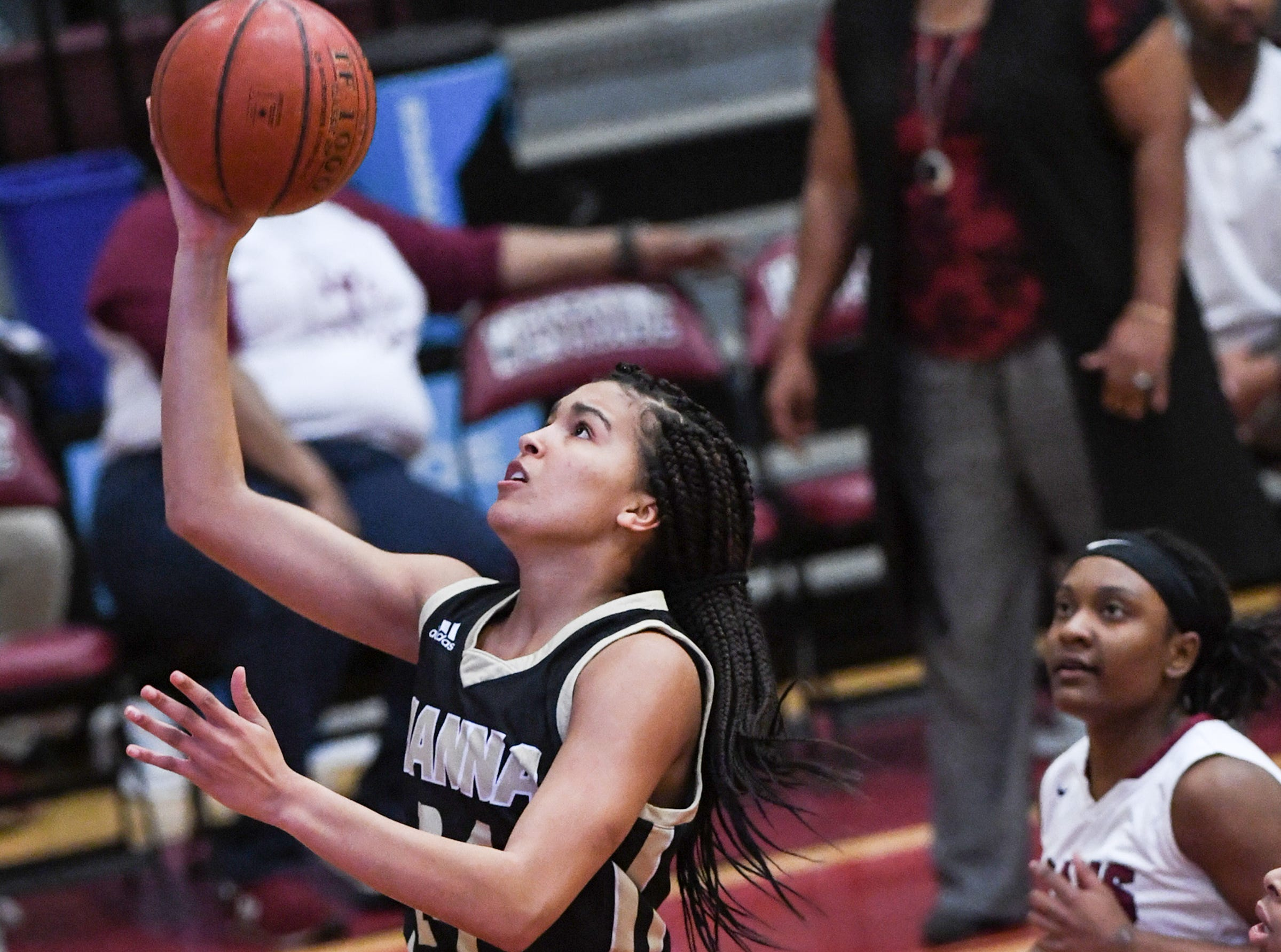 TL Hanna junior Maleia Bracone(24) shoots during the first quarter at Westside High School in Anderson on Friday.