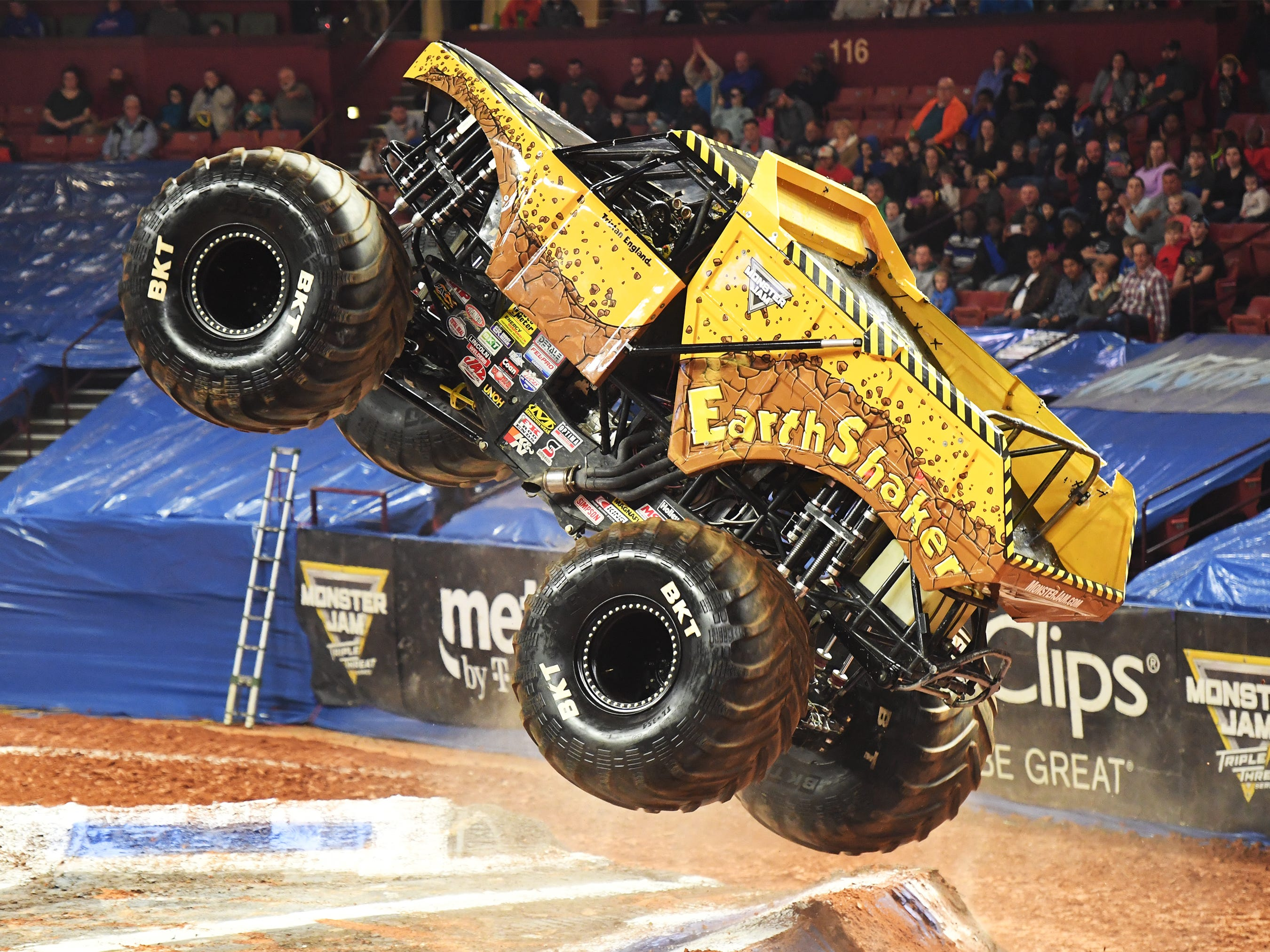 Tristan England celebrates winning the first race while driving the Earth Shaker at Monster Jam at Bon Secours Wellness Arena Friday, Feb. 8, 2019.