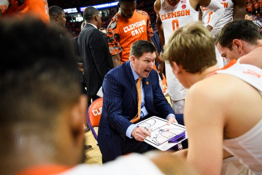 Clemson head coach Brad Brownell strategizes with his players during a timeout in the second of their game against Virginia Tech at Littlejohn Coliseum on Saturday, Feb. 9, 2019.