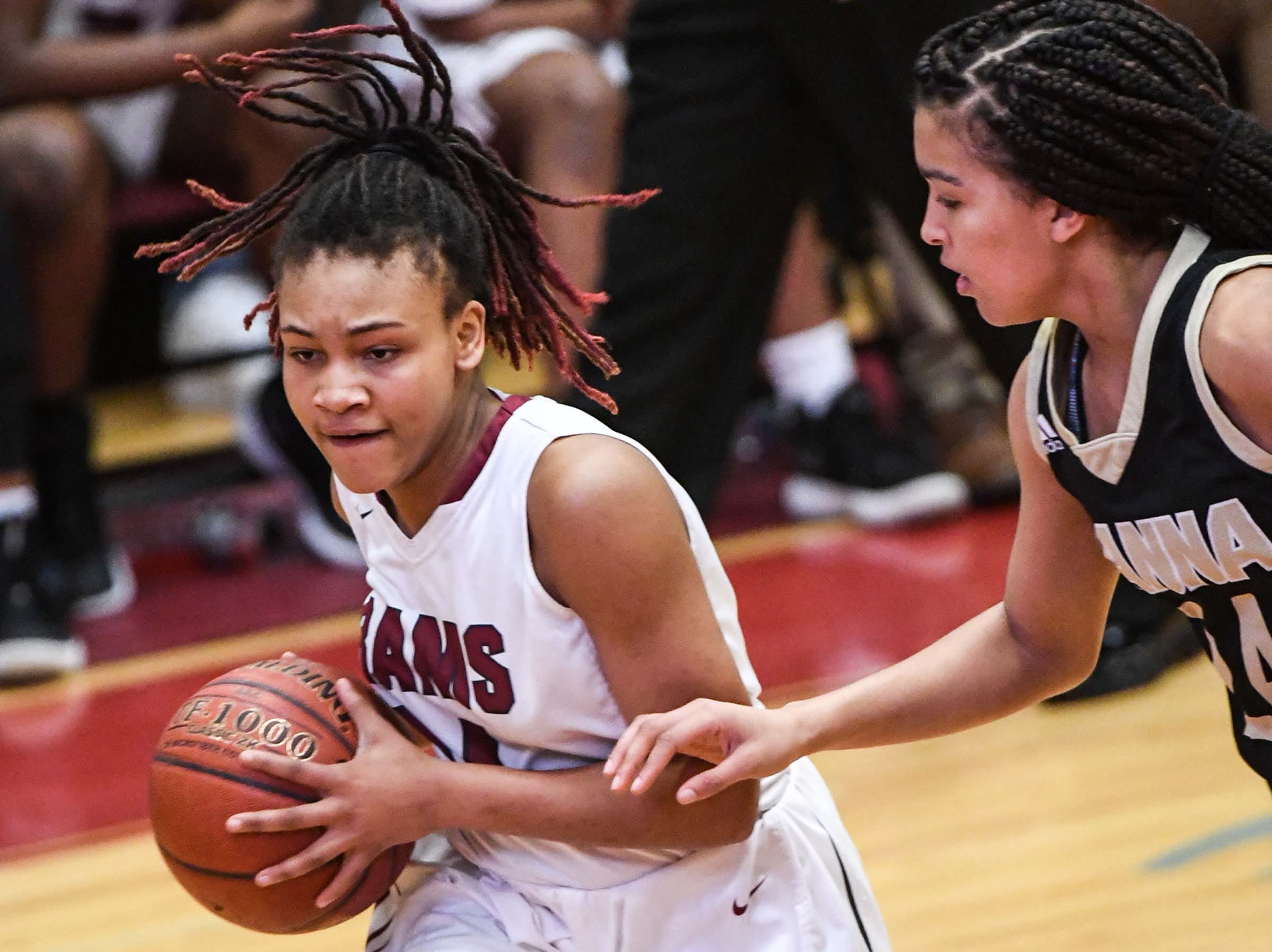Westside junior Tatyana Lewis(14) dribbles near TL Hanna junior Maleia Bracone(24) during the fourth quarter at Westside High School in Anderson on Friday. Westside won 54-46.