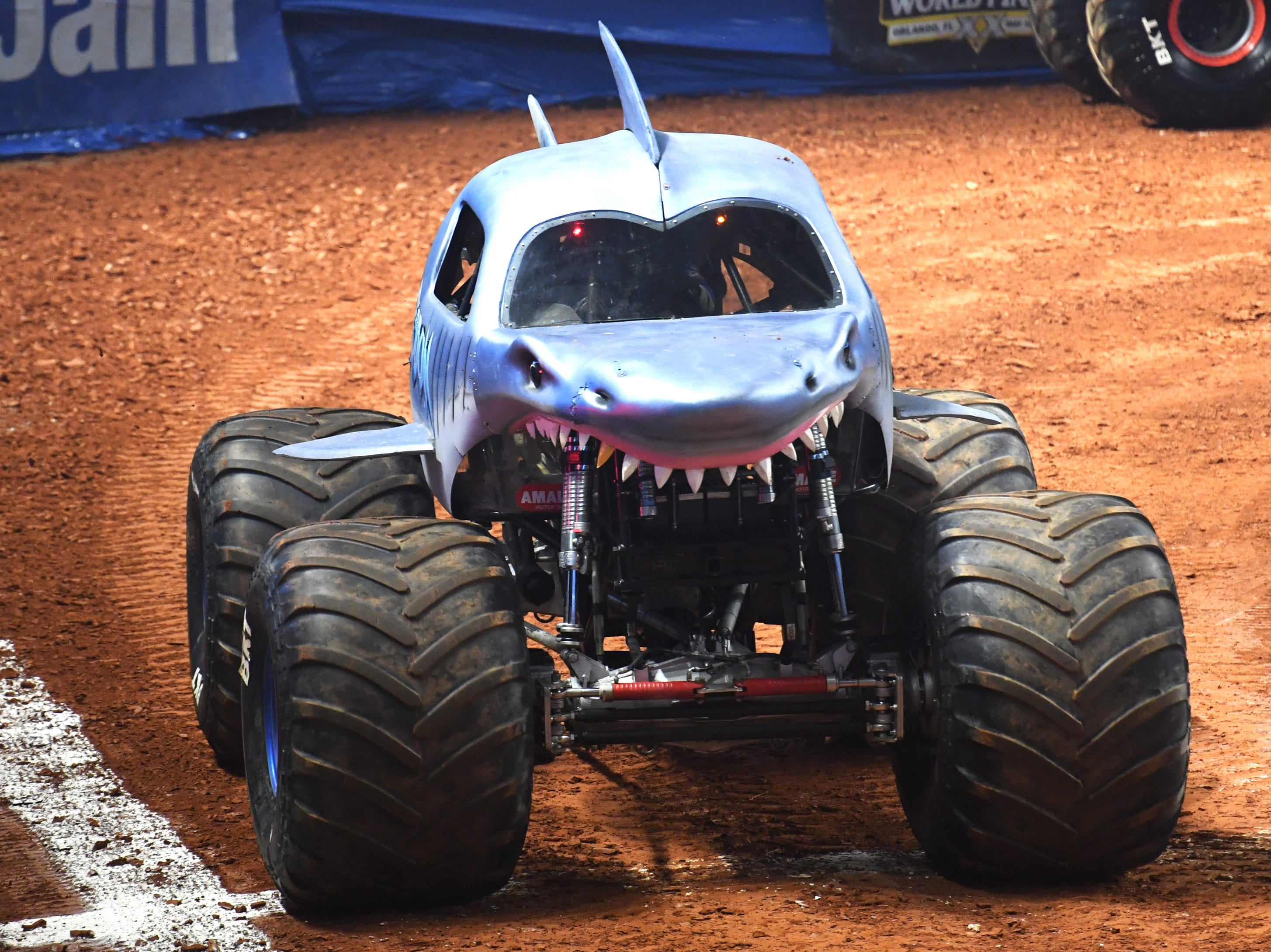 A driver competes in Megalodon during the Monster Jam Racing competition at Bon Secours Wellness Arena Friday, Feb. 8, 2019.