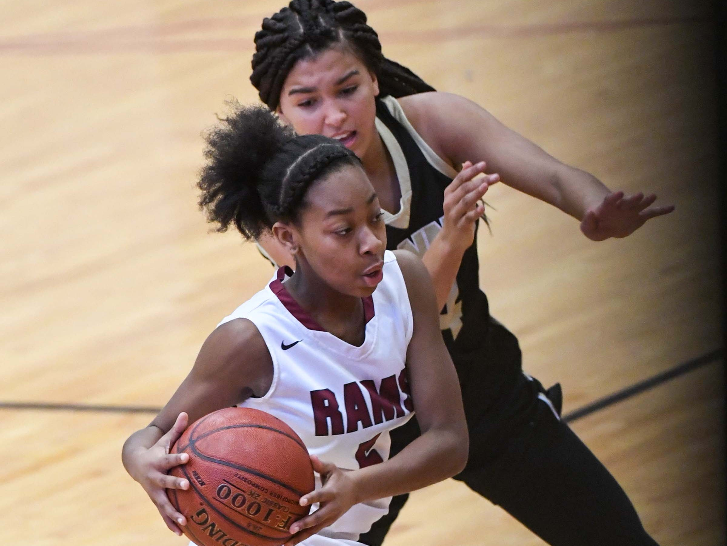 Westside senior Chelsea Adger(5) dribbles near TL Hanna junior Maleia Bracone(24) during the fourth quarter at Westside High School in Anderson on Friday. Westside won 54-46.
