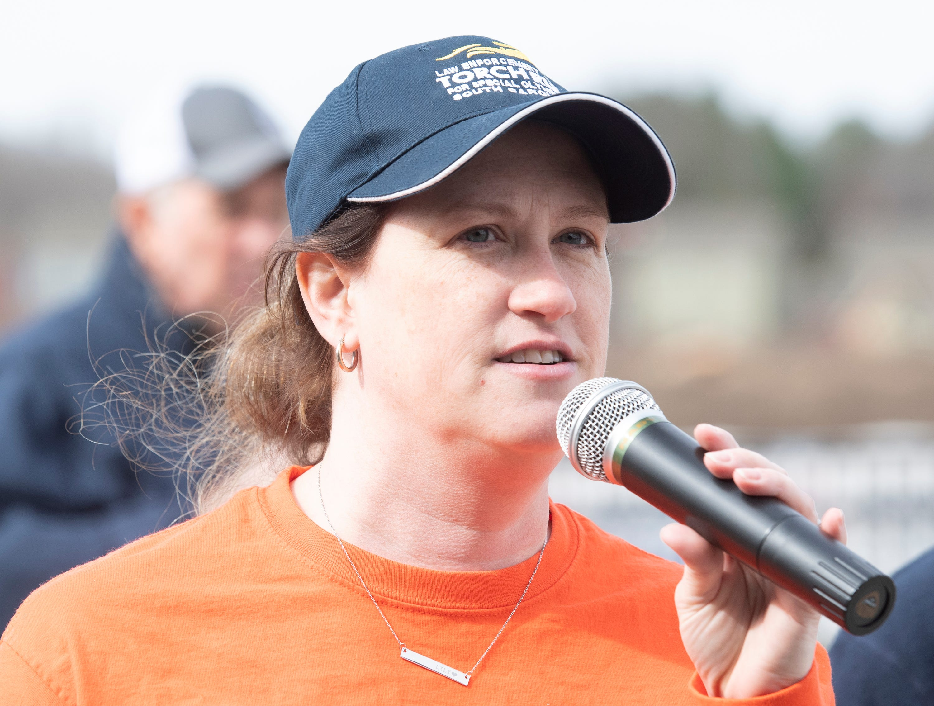 Leigh Lowery, director of communications for Special Olympics South Carolina, address the crowd gathered for the 2019 Tiger Paw Polar Plunge at in the pool at The Pier housing complex in Seneca Saturday, Feb. 9, 2019.