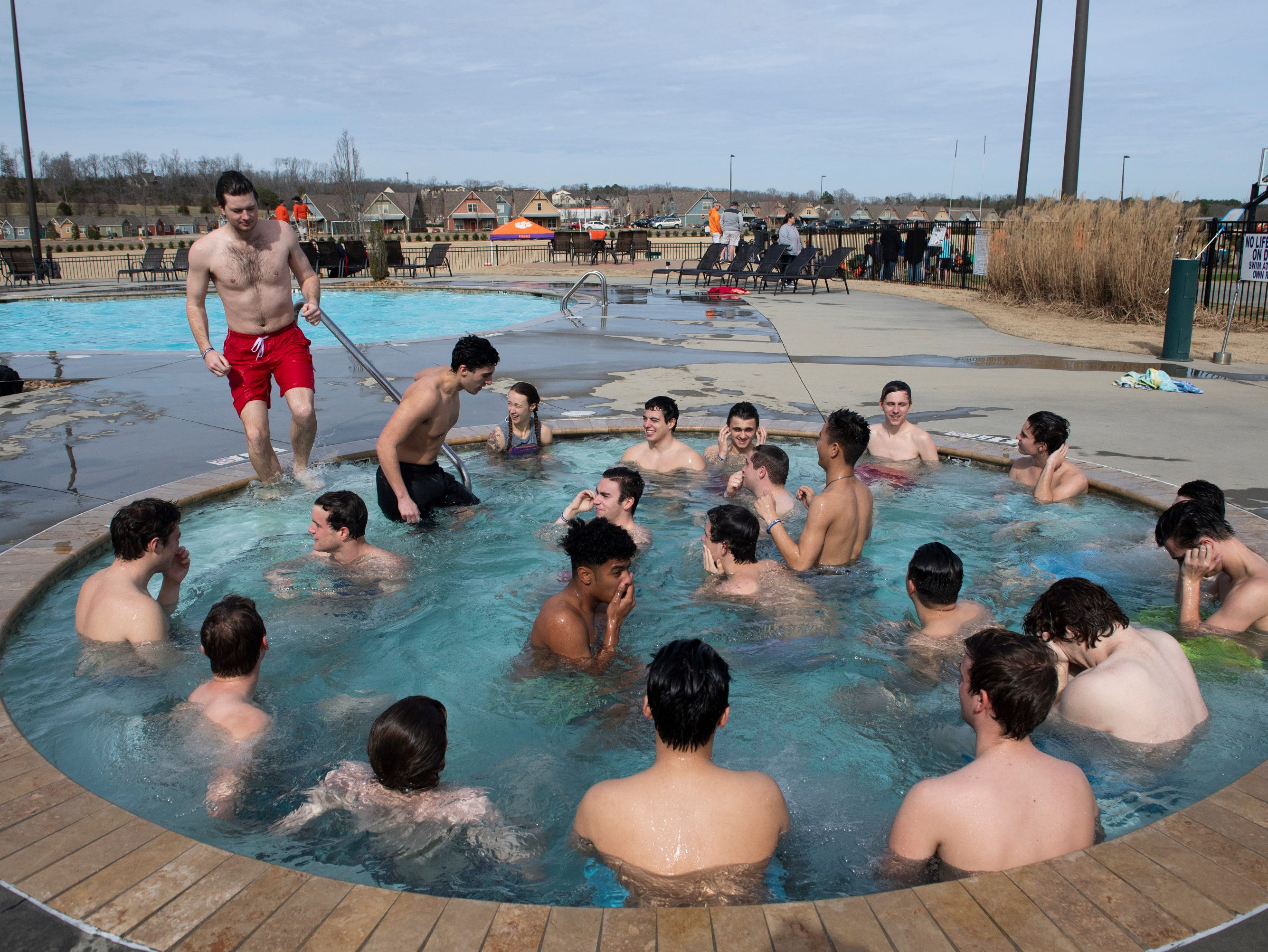 Participants in the 2019 Tiger Paw Polar Plunge warm up in the hot tub after jumping in to the cold pool at The Pier housing complex in Seneca Saturday, Feb. 9, 2019.