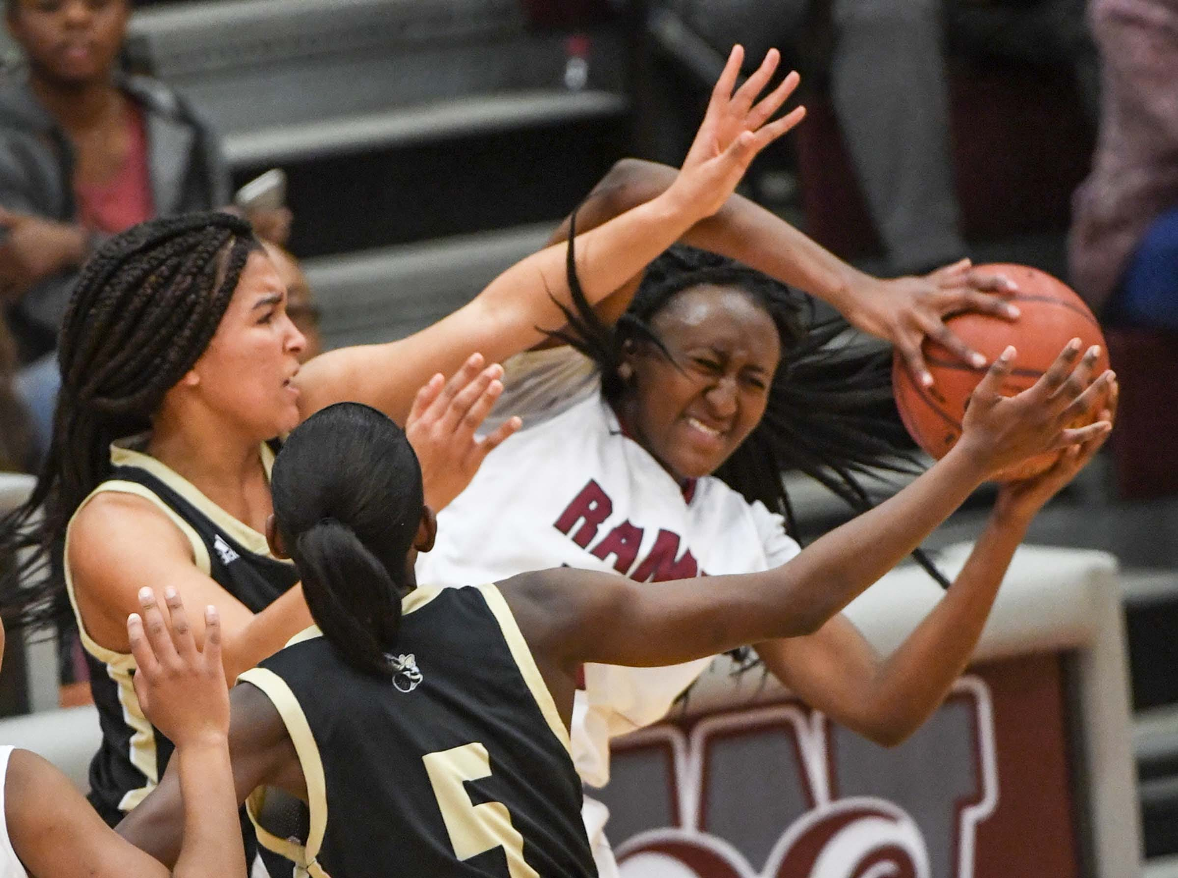 Westside junior Keyshuna Fair(25) rebounds near TL Hanna junior Maleia Bracone(24) during the fourth quarter at Westside High School in Anderson on Friday. Westside won 54-46.