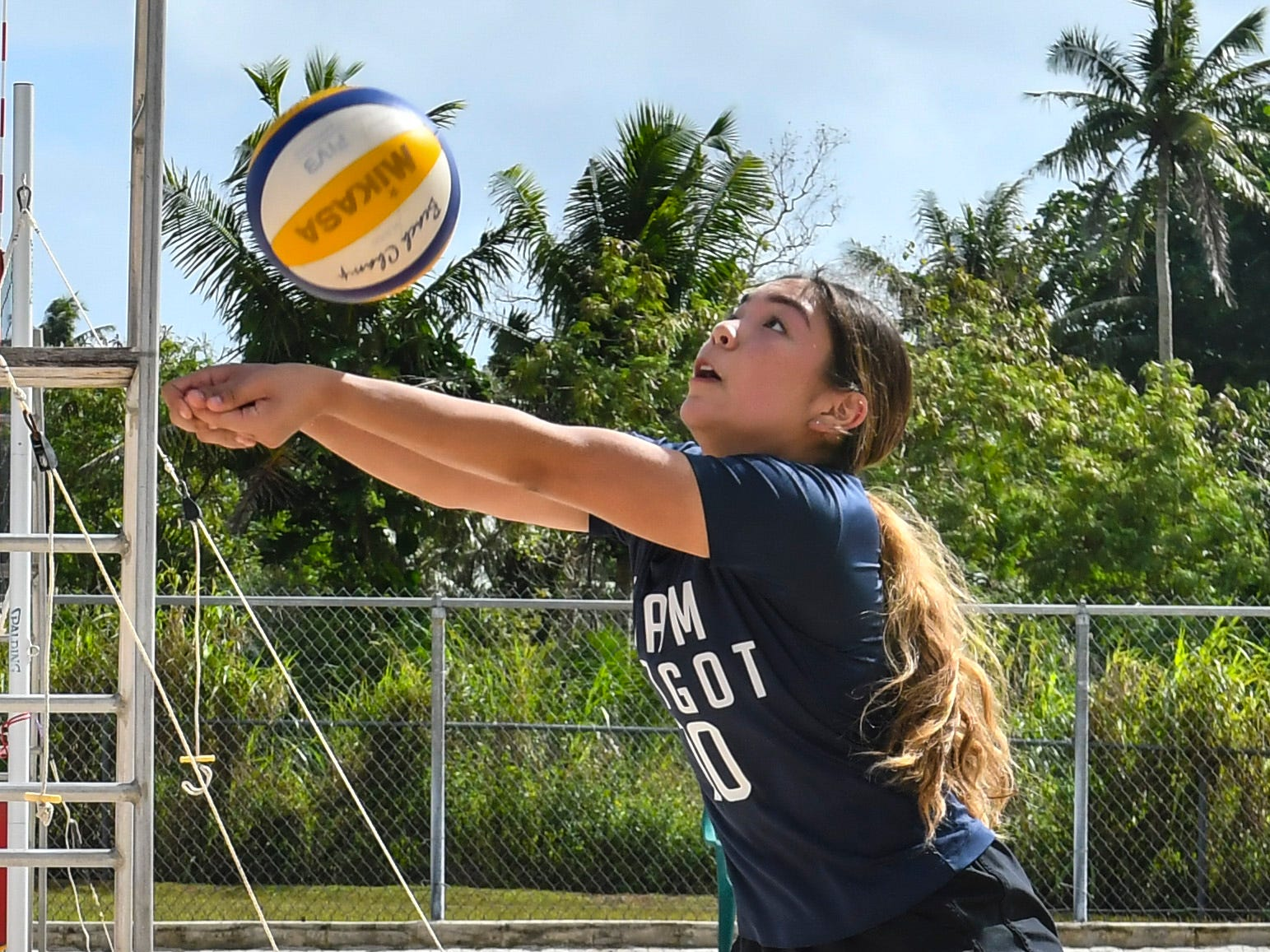 Harvest Christian Academy Eagles' Trinity Terlaje, returns a volley during an IIAAG beach volleyball game against St. John's Knights White team at the Guam Football Association National Training Center in Dededo on Saturday, Feb. 9, 2019.
