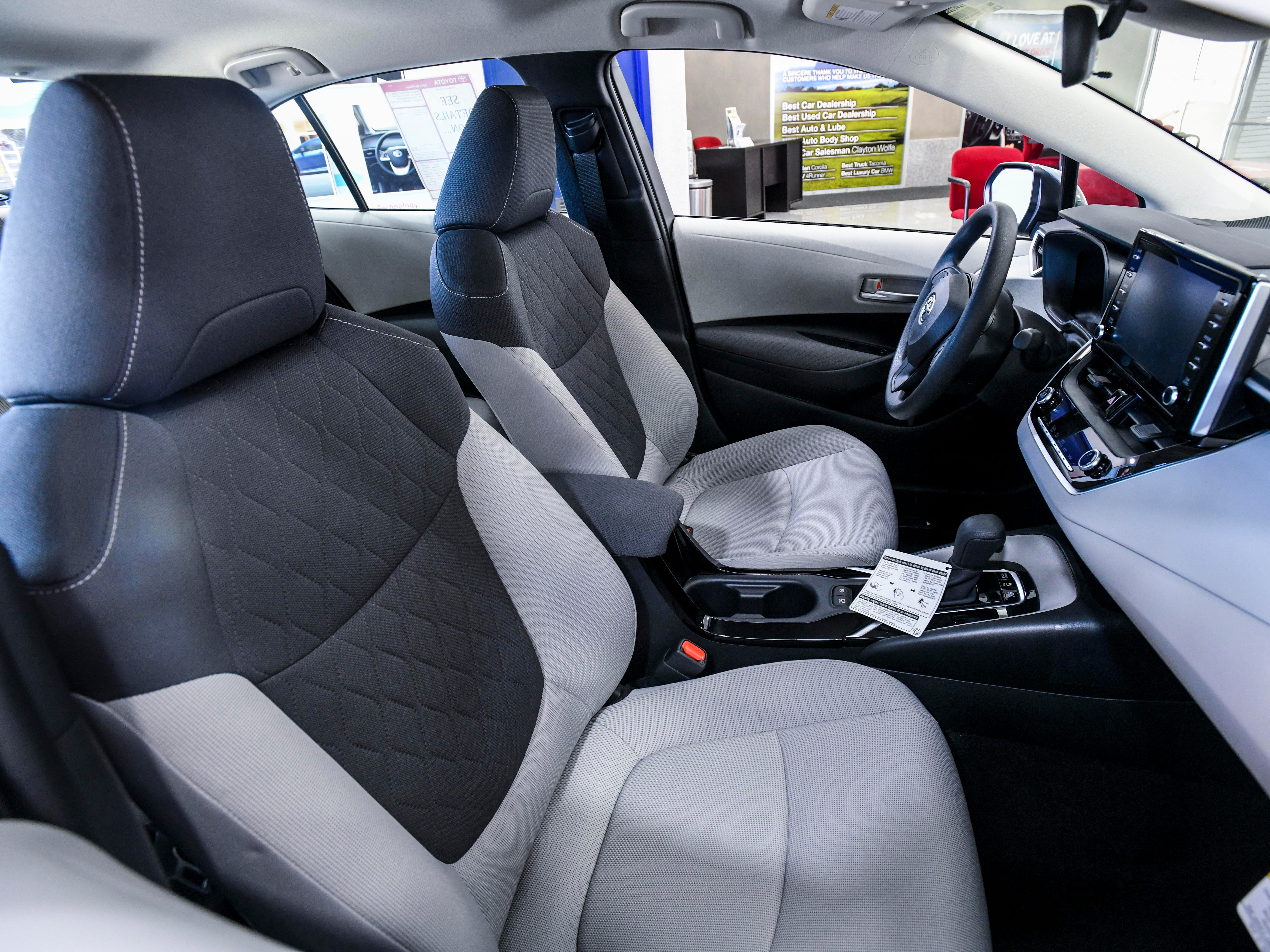 A look at the front seat interior of the 2020 Toyota Corolla HE (Hybrid Edition), as seen on the showroom floor of the Atkins Kroll dealership, in Tamuning on Saturday, Feb. 9, 2019. The newly redesigned vehicle is one of three models introduced and available at Atkins Kroll Toyota. Other models include the Toyota Corolla LE (Luxury Edition) and the Toyota Corolla SE (Sport Edition).