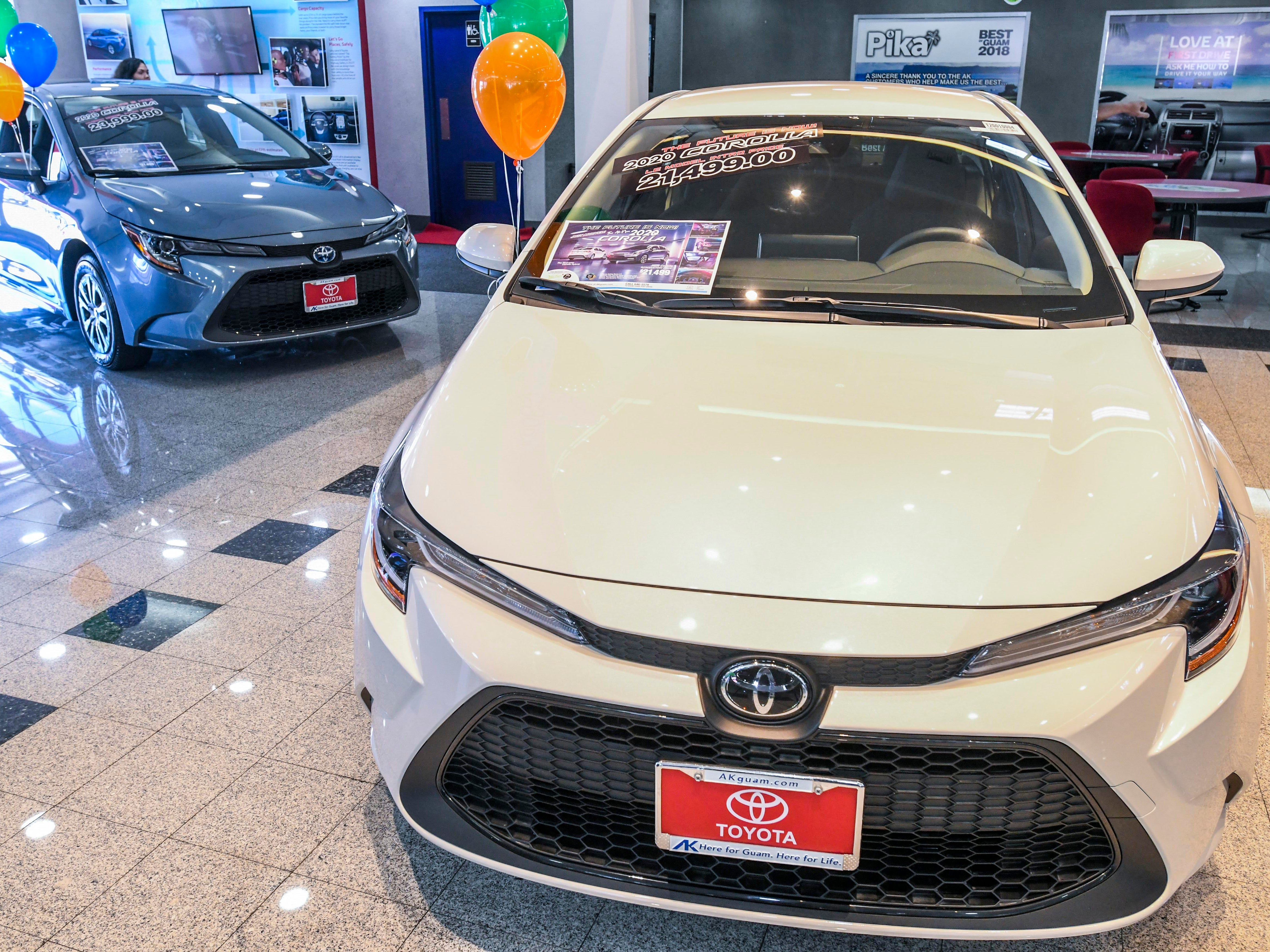 Two models of the newly redesigned 2020 Toyota Corolla, as seen on the showroom floor of the Atkins Kroll dealership in Tamuning, on Saturday, Feb. 9, 2019. Atkins Kroll has rolled out three models of the sedan: Toyota Corolla LE (Luxury Edition), front; the Toyota Corolla HE (Hybrid Edition), back, and a Toyota Corolla SE (Sport Edition), not seen.