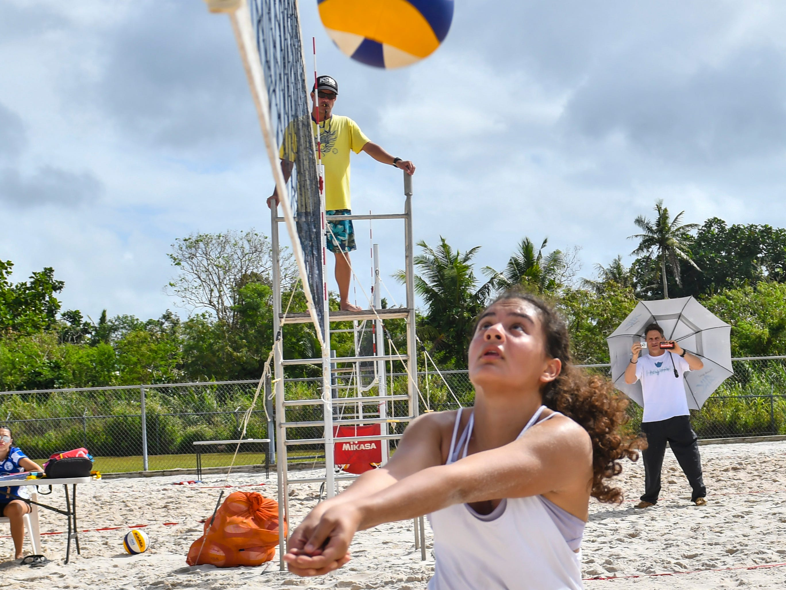 St. John's Knights White's Hana Fernandez chases a ball to the sideline during an IIAAG beach volleyball game against the Harvest Christian Academy Eagles at the Guam Football Association National Training Center in Dededo on Saturday, Feb. 9, 2019.
