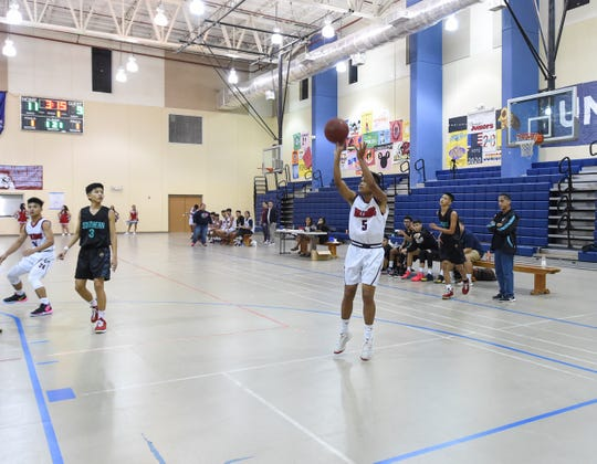 In this Feb. 8 file photo, Okkodo player Nico Bonita shoots a mid-range jump shot against the Southern High Dolphins during a IIAAG Boys Basketball game at the Okkodo High School Gym. Bonita scored 10 against the St. John's Knights on Saturday.