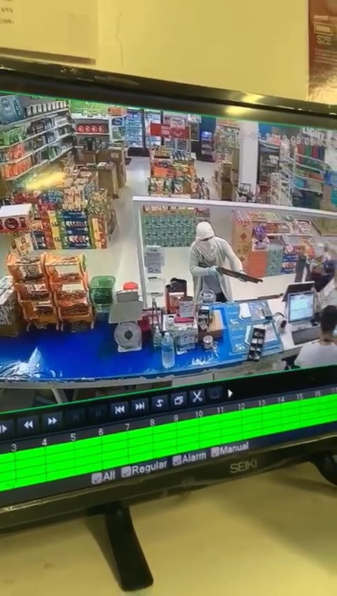Frame from security footage showing suspect who robbed Loco Mart on Feb. 8, 2019.