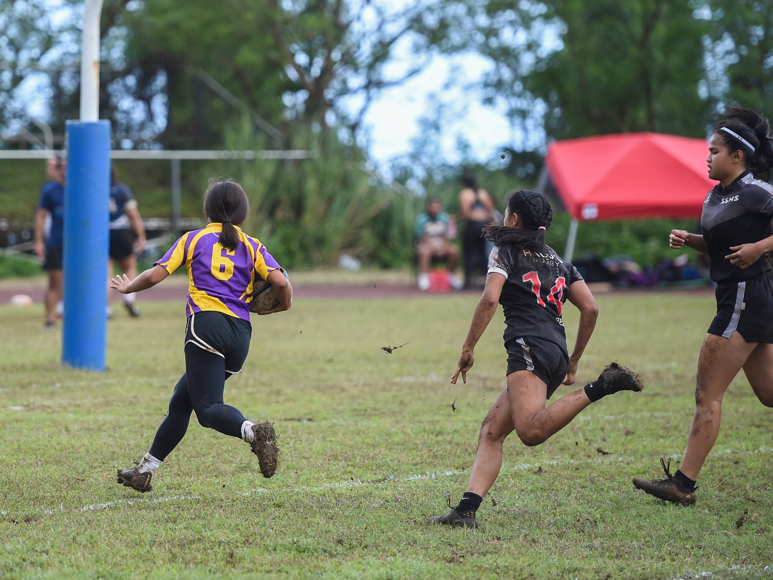 Aveah Garrido (6) sprints toward the goal line against the Simon Sanchez Sharks for their IIAAG Girls' Rugby match at the Southern High School Field, Feb. 9, 2019.