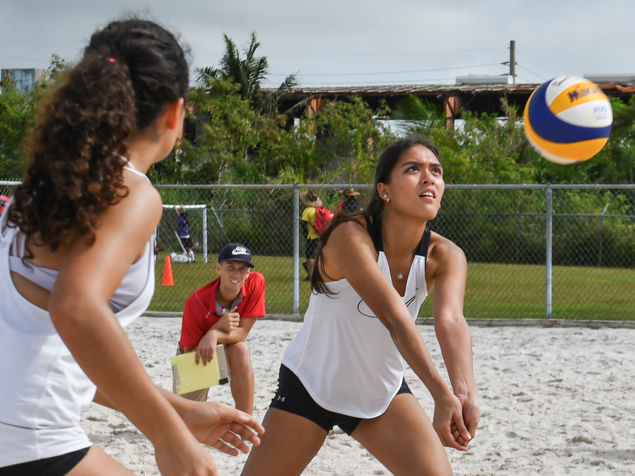 St. John's Knights White's Laressa Halladay bumps a volley over the net during an IIAAG beach volleyball game against the Harvest Christian Academy Eagles at the Guam Football Association National Training Center in Dededo on Saturday, Feb. 9, 2019.