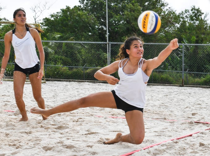 St. John's Knights White's Hana Fernandez stretches out of bounds to keep a ball in play during an IIAAG beach volleyball game against the Harvest Christian Academy Eagles at the Guam Football Association National Training Center in Dededo on Saturday, Feb. 9, 2019. The Knights jousted the Eagles for the win after three set: 21-15, 17-21 and 15-8.