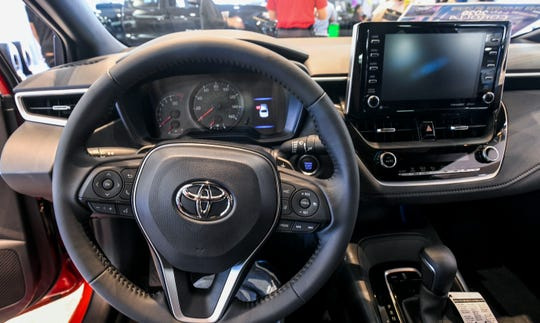 The driver's perspective of the controls in the Toyota Corolla SE (Sport Edition).