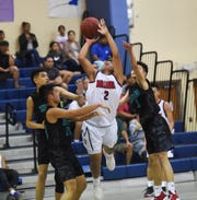 The Okkodo Bulldogs play the Southern High Dolphins in an IIAAG Boys Basketball game in this Feb. 8 file photo. As proposed, the Interscholastic Sports Association Boys Basketball season will last just over a month, with games three times per week using a double round-robin format