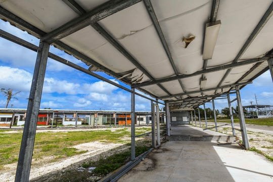 Steel framed structures that once housed concession booths for the Liberation Day celebrations at Tiyan, are now void of most its walls, siding and roll-up doors, as seen on Wednesday, Feb. 6, 2019.