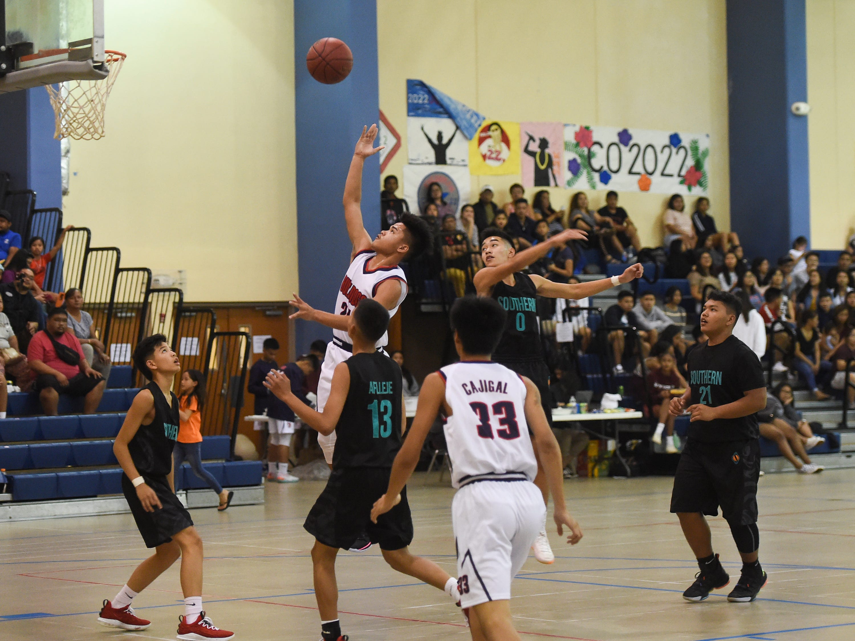 Okkodo's Kobe Santos (24) drives to the bucket against the Southern Dolphins during their IIAAG Boys' Basketball game at the Okkodo High School Gym, Feb. 8, 2019.