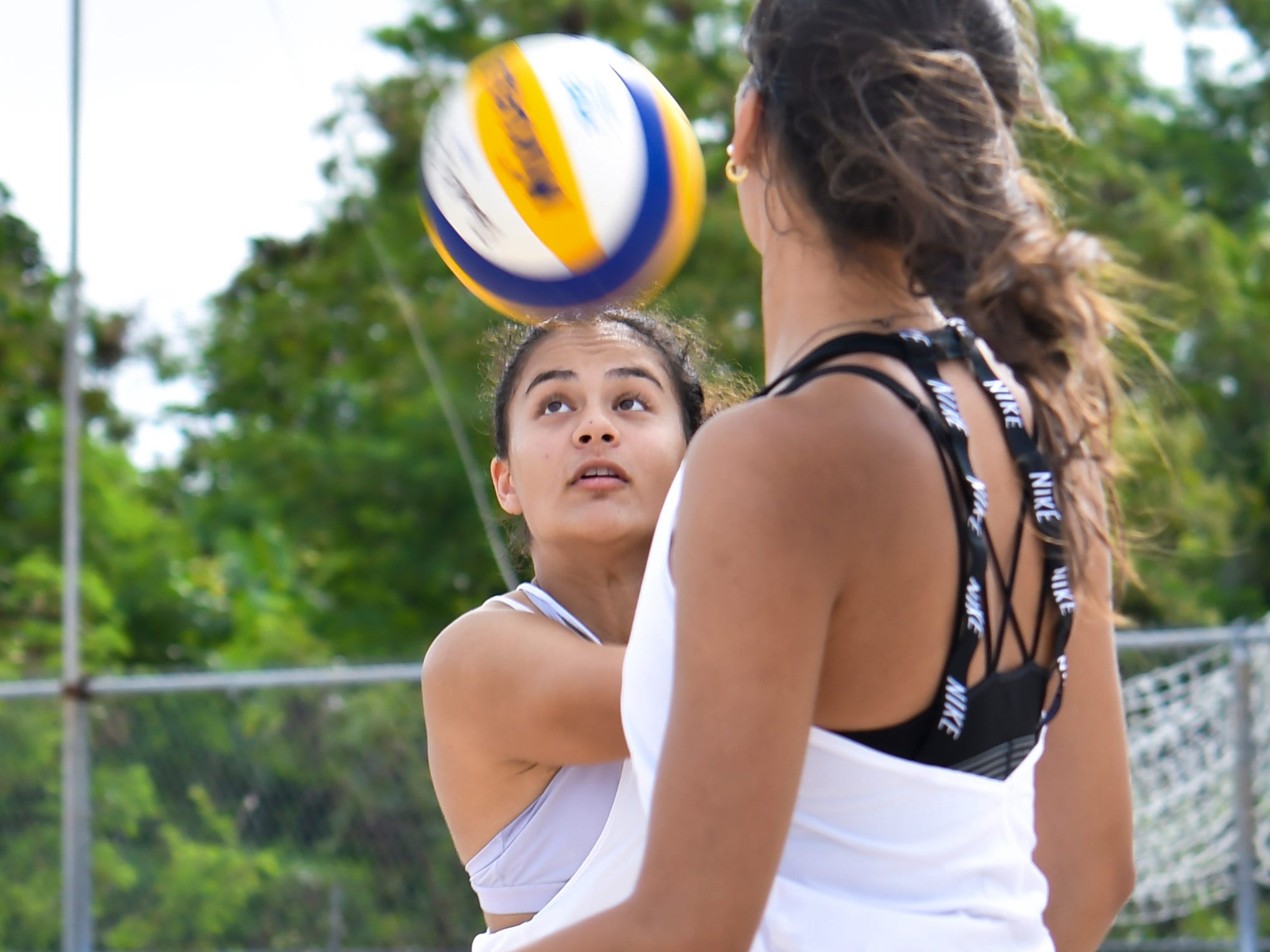 St. John's Knights White's Hana Fernandez maintains eye contact with the ball during an IIAAG beach volleyball game against the Harvest Christian Academy Eagles at the Guam Football Association National Training Center in Dededo on Saturday, Feb. 9, 2019.
