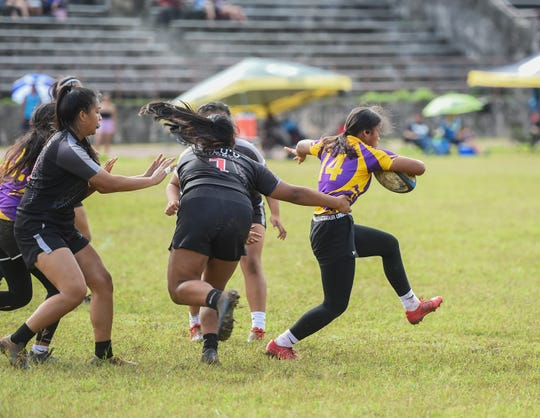 The GW Geckos and Simon Sanchez Sharks battle in the IIAAG/GRFU High School Girls Rugby in this Feb. 9 file photo.