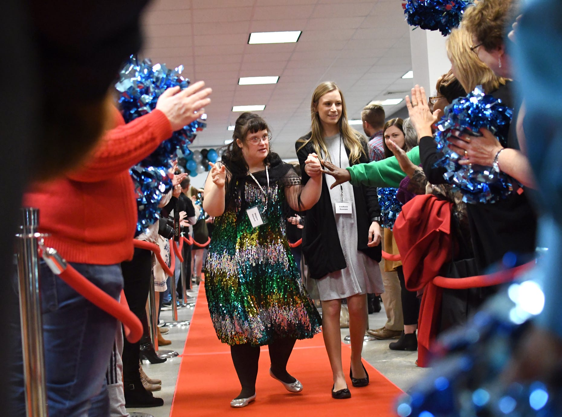 Guest walk down the red carpet during the Night to Shine Prom at Temple Baptist Church on Friday, February 8, 2019. Churches around the world hosted the prom by the Tim Tebow Foundation for people with special needs.