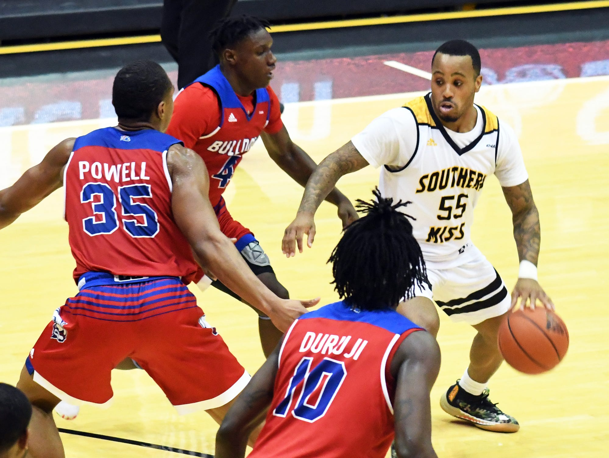 Southern Miss guard Tyree Griffin fights off a defender in a game against Louisiana Tech in Reed Green Coliseum on Saturday, February 9, 2019.