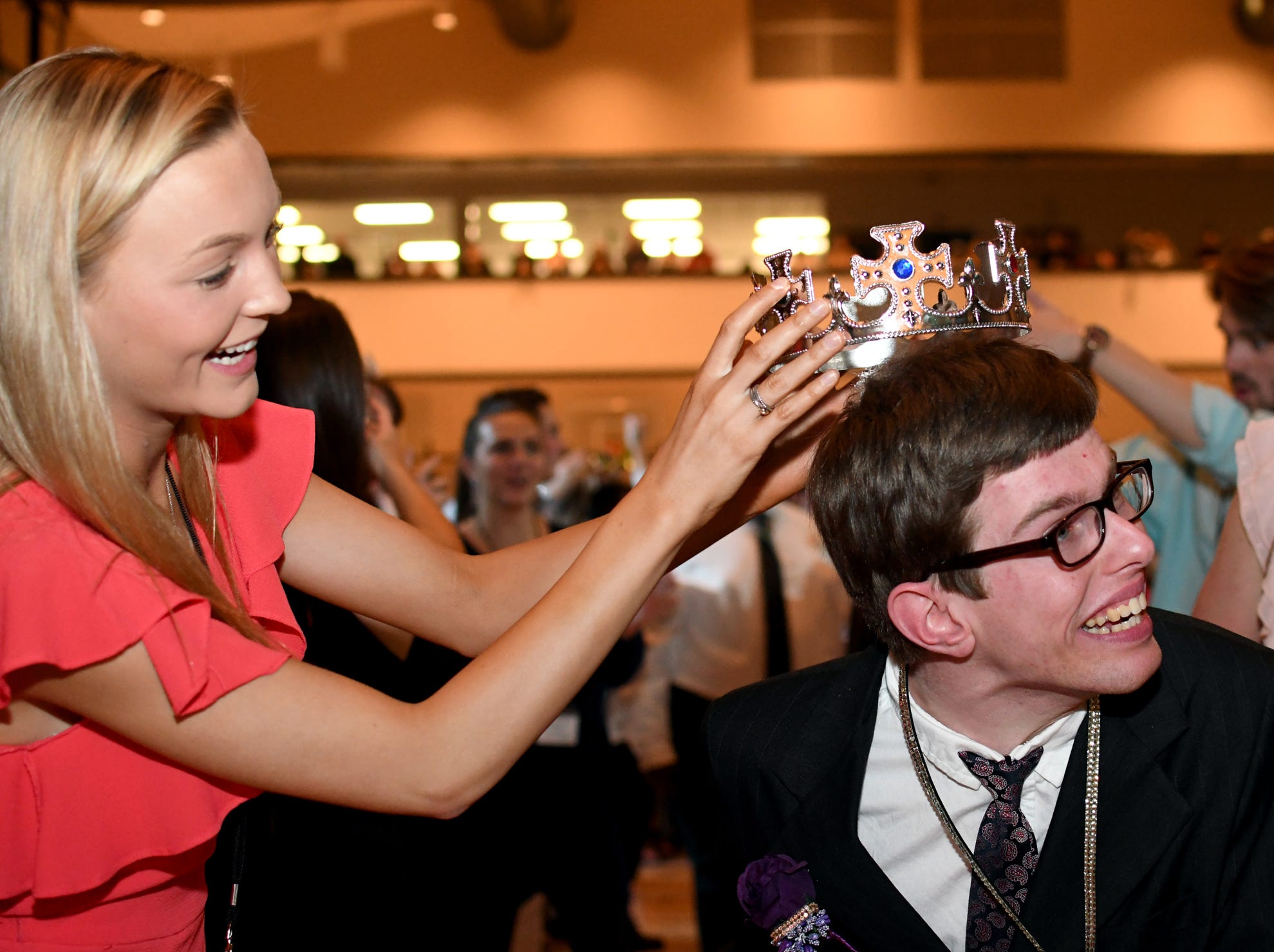 Maggie Starns crowns Matthew Meyer during the Night to Shine Prom at Temple Baptist Church on Friday, February 8, 2019. Churches around the world hosted the prom by the Tim Tebow Foundation for people with special needs.