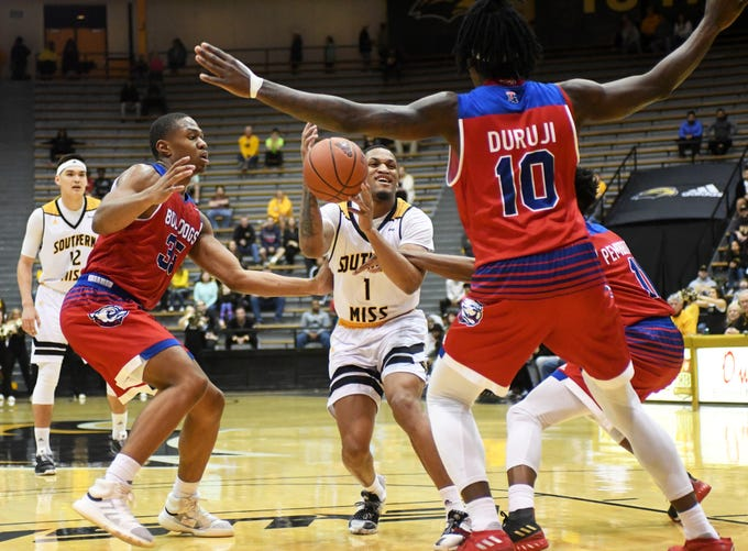 Southern Miss guard Cortez Edwards fights off a defender in a game against Louisiana Tech in Reed Green Coliseum on Saturday, February 9, 2019.