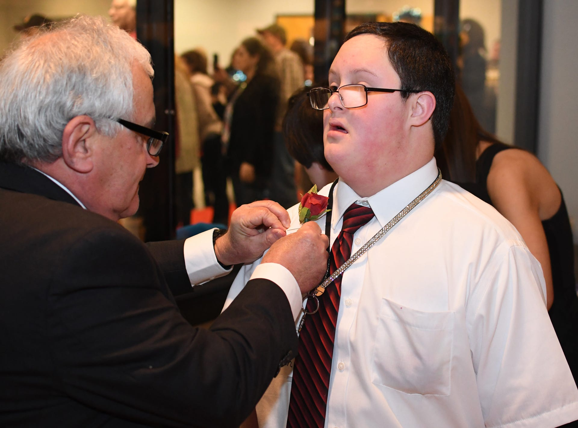 A prom guest is presented a boutonniere during the Night to Shine Prom at Temple Baptist Church on Friday, February 8, 2019. Churches around the world hosted the prom by the Tim Tebow Foundation for people with special needs.