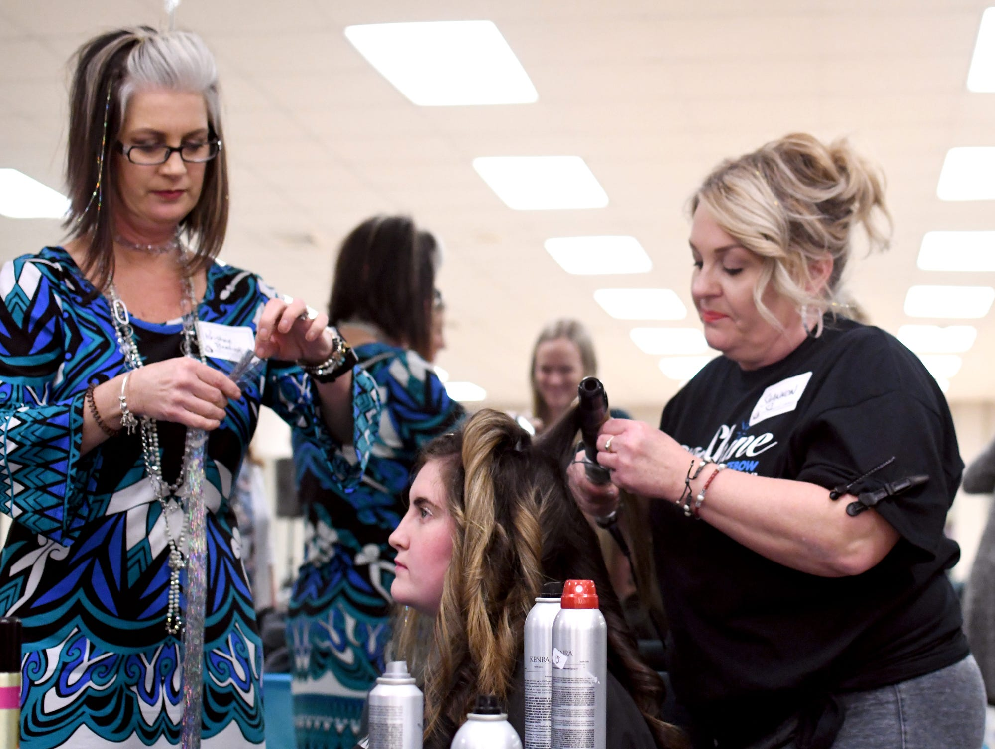 Prom guests get their hair and makeup done during the Night to Shine Prom at Temple Baptist Church on Friday, February 8, 2019. Churches around the world hosted the prom by the Tim Tebow Foundation for people with special needs.