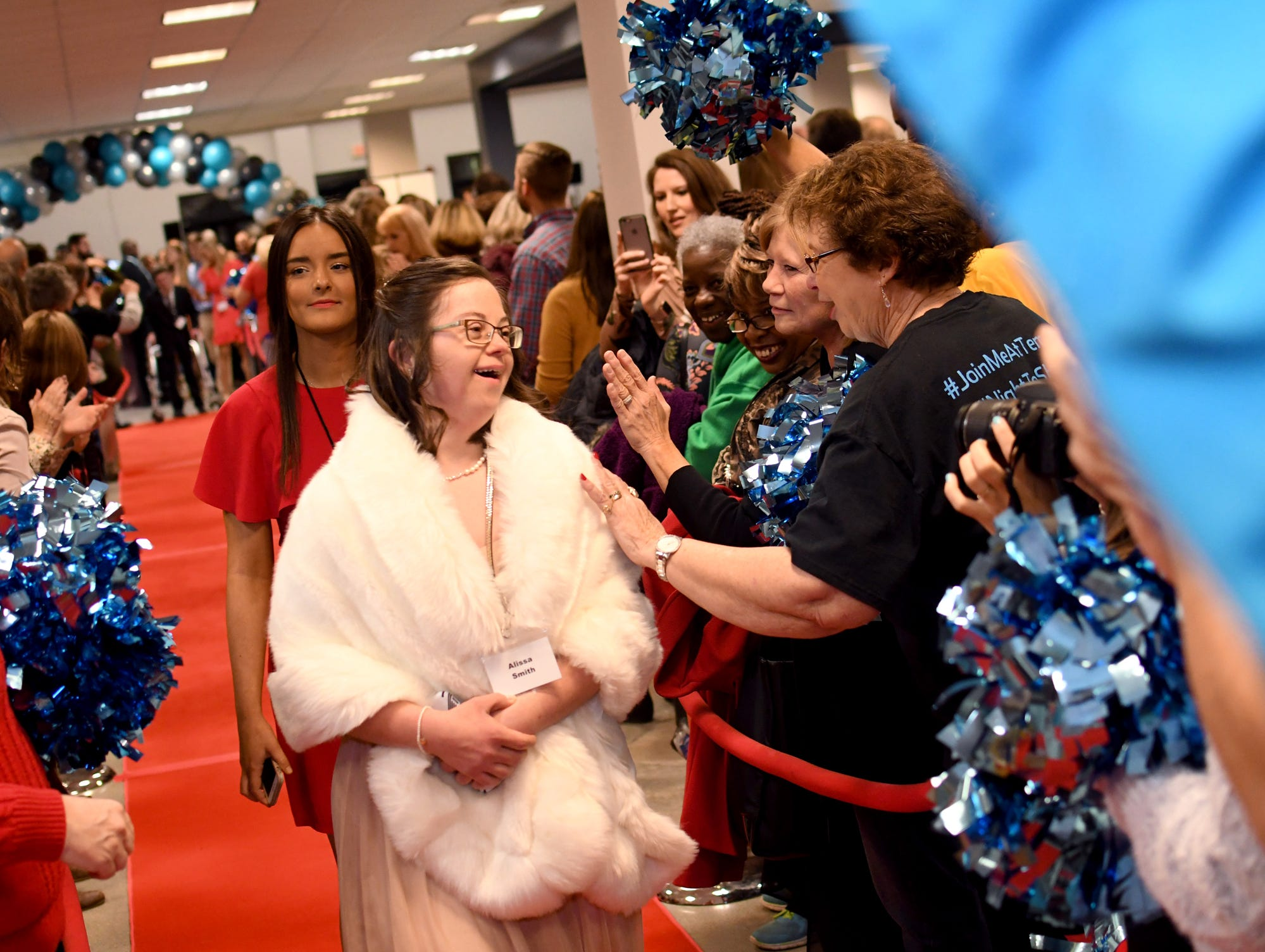 Alissa Smith greets guests as she walks down the red carpet during the Night to Shine Prom at Temple Baptist Church on Friday, February 8, 2019. Churches around the world hosted the prom by the Tim Tebow Foundation for people with special needs.