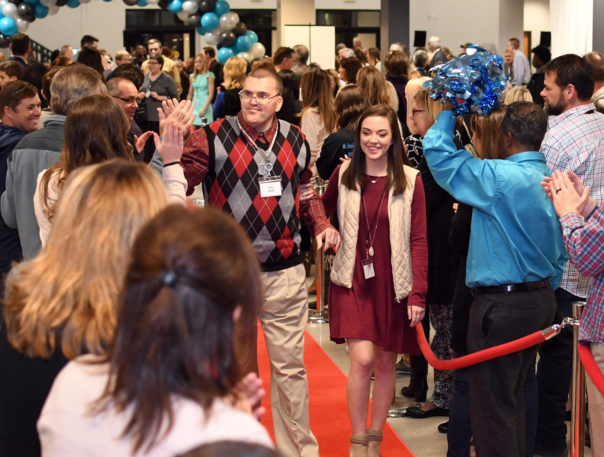 Guests walk down the red carpet during the Night to Shine Prom at Temple Baptist Church on Friday, February 8, 2019. Churches around the world hosted the prom by the Tim Tebow Foundation for people with special needs.