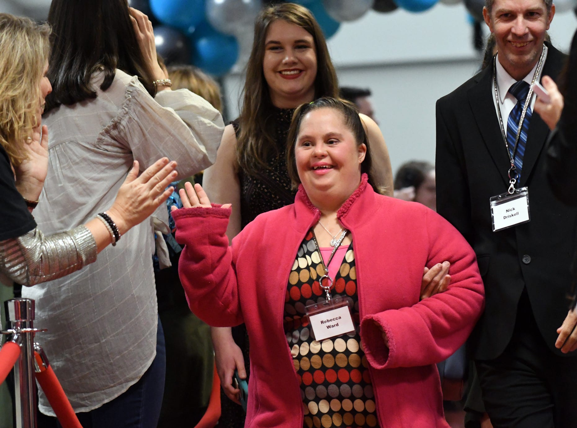 Rebecca Ward greets guests as she walks down the red carpet during the Night to Shine Prom at Temple Baptist Church on Friday, February 8, 2019. Churches around the world hosted the prom by the Tim Tebow Foundation for people with special needs.