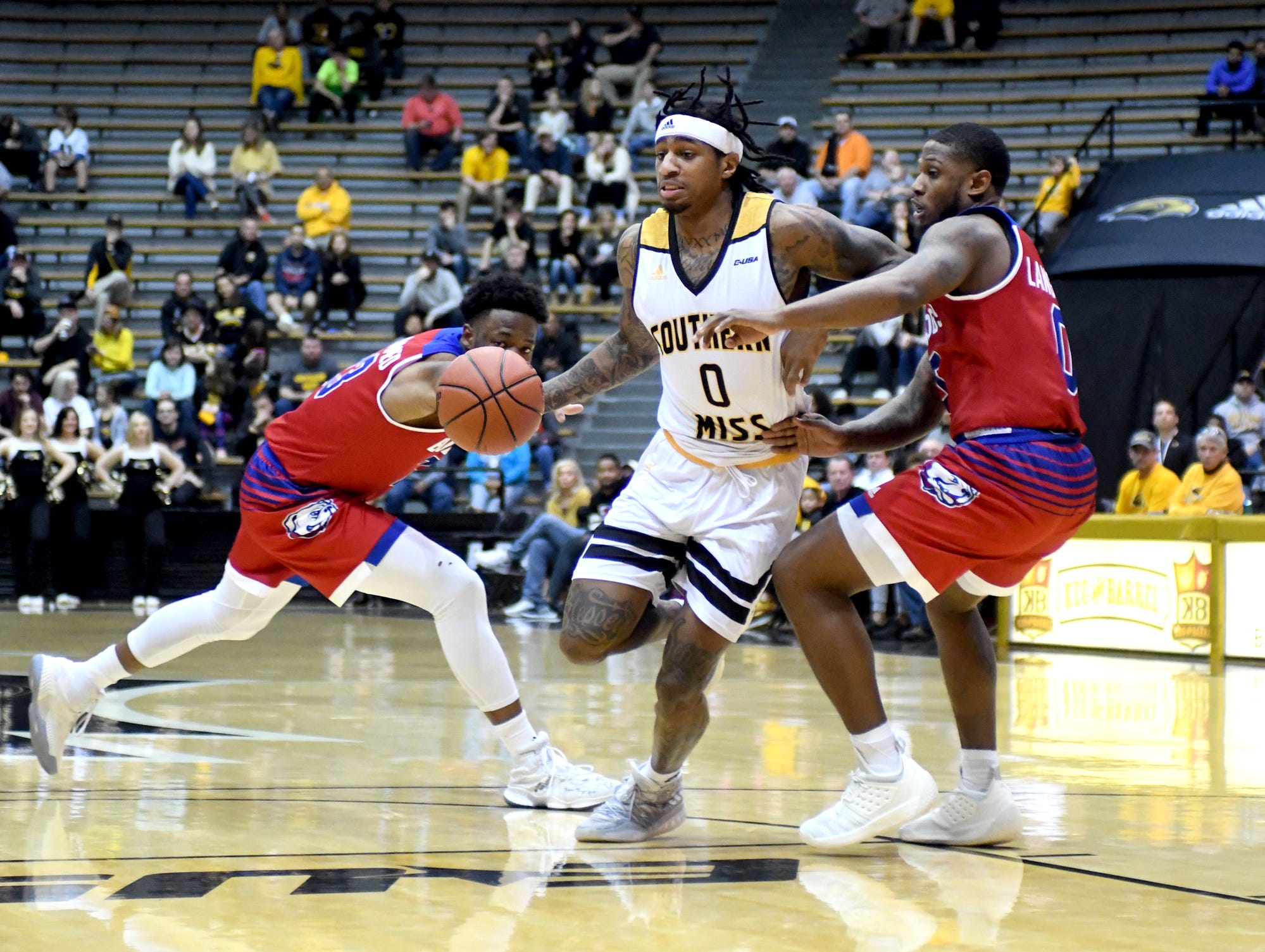 Southern Miss guard Dominic Magee fights off defenders in a game against Louisiana Tech in Reed Green Coliseum on Saturday, February 9, 2019.
