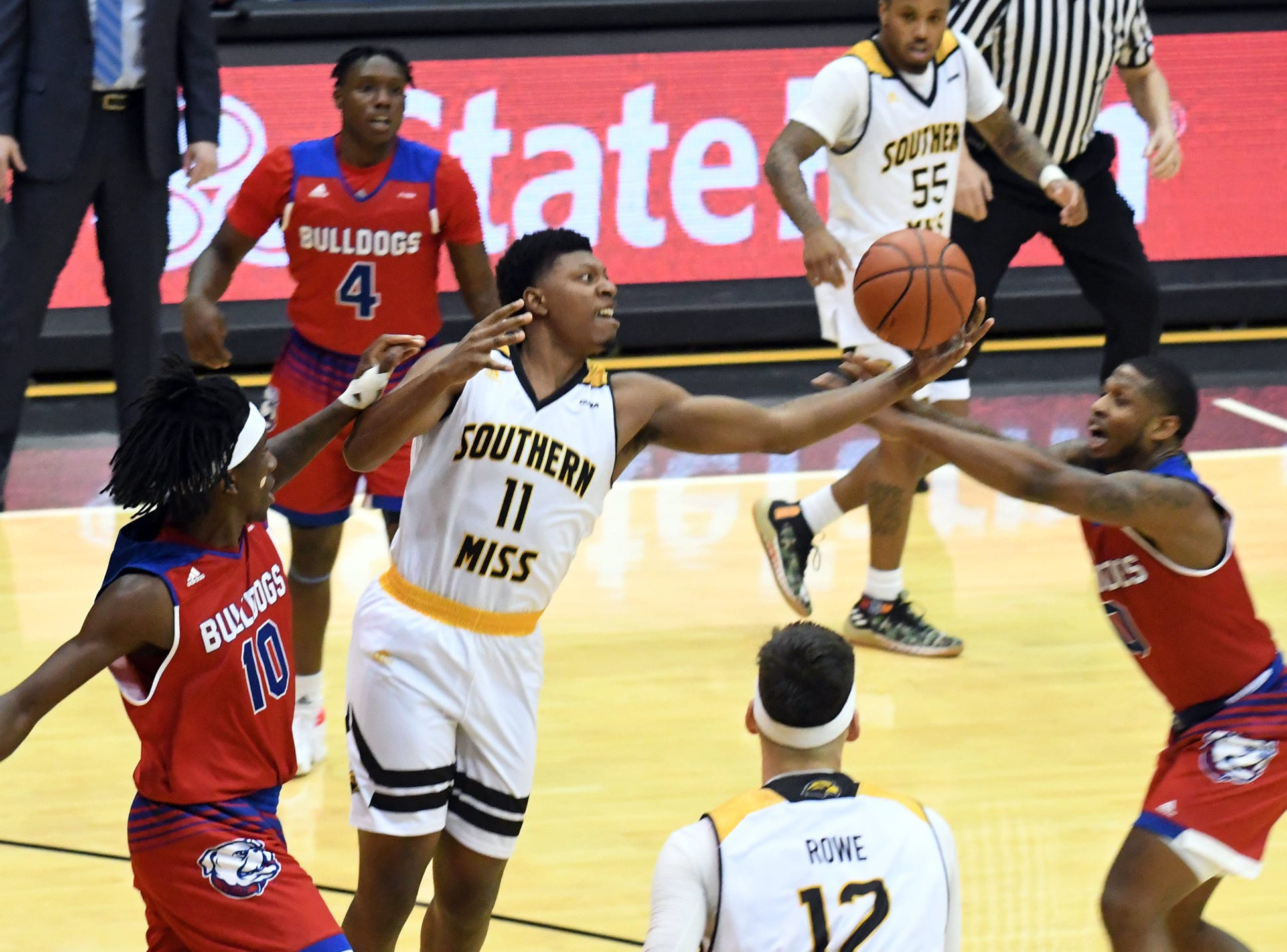 Southern Miss guard Ladavius Draine reaches for a rebound in a game against Louisiana Tech in Reed Green Coliseum on Saturday, February 9, 2019.