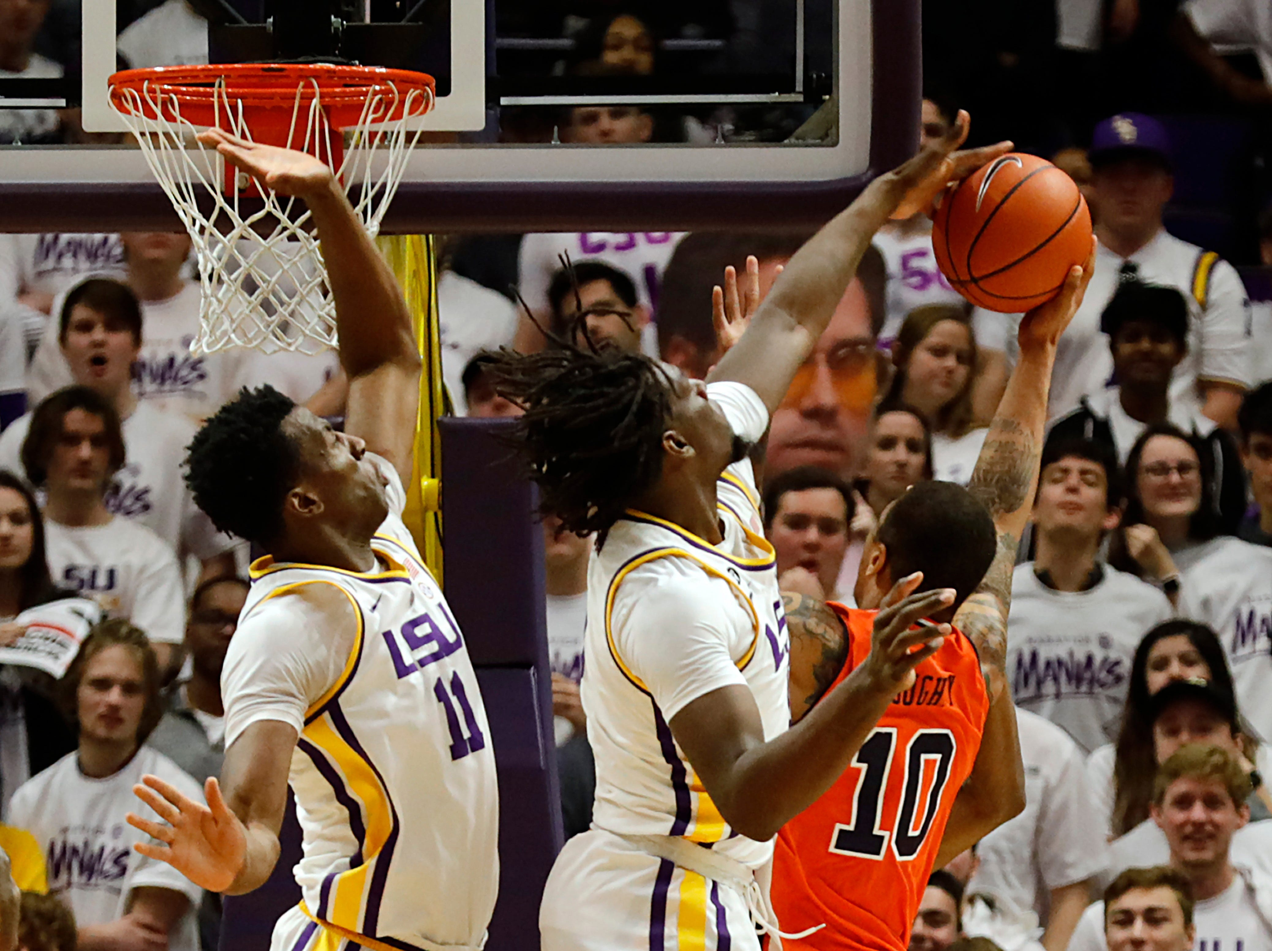 Feb 9, 2019; Baton Rouge, LA, USA; LSU Tigers forward Naz Reid (0) blocks the shot of Auburn Tigers guard Samir Doughty (10) in the second half at Maravich Assembly Center. Mandatory Credit: Stephen Lew-USA TODAY Sports