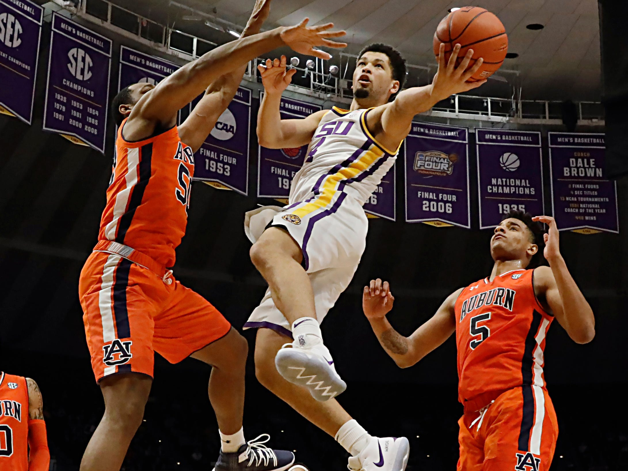 Feb 9, 2019; Baton Rouge, LA, USA; LSU Tigers guard Skylar Mays (4) drives to the basket against Auburn Tigers center Austin Wiley (50) in the second half at Maravich Assembly Center. Mandatory Credit: Stephen Lew-USA TODAY Sports