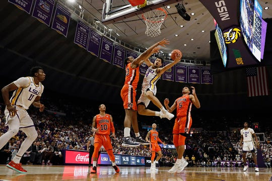 LSU guard Skylar Mays (4) drives to the basket against Auburn Tigers center Austin Wiley (50) in the second half at Maravich Assembly Center on Feb. 9, 2019.
