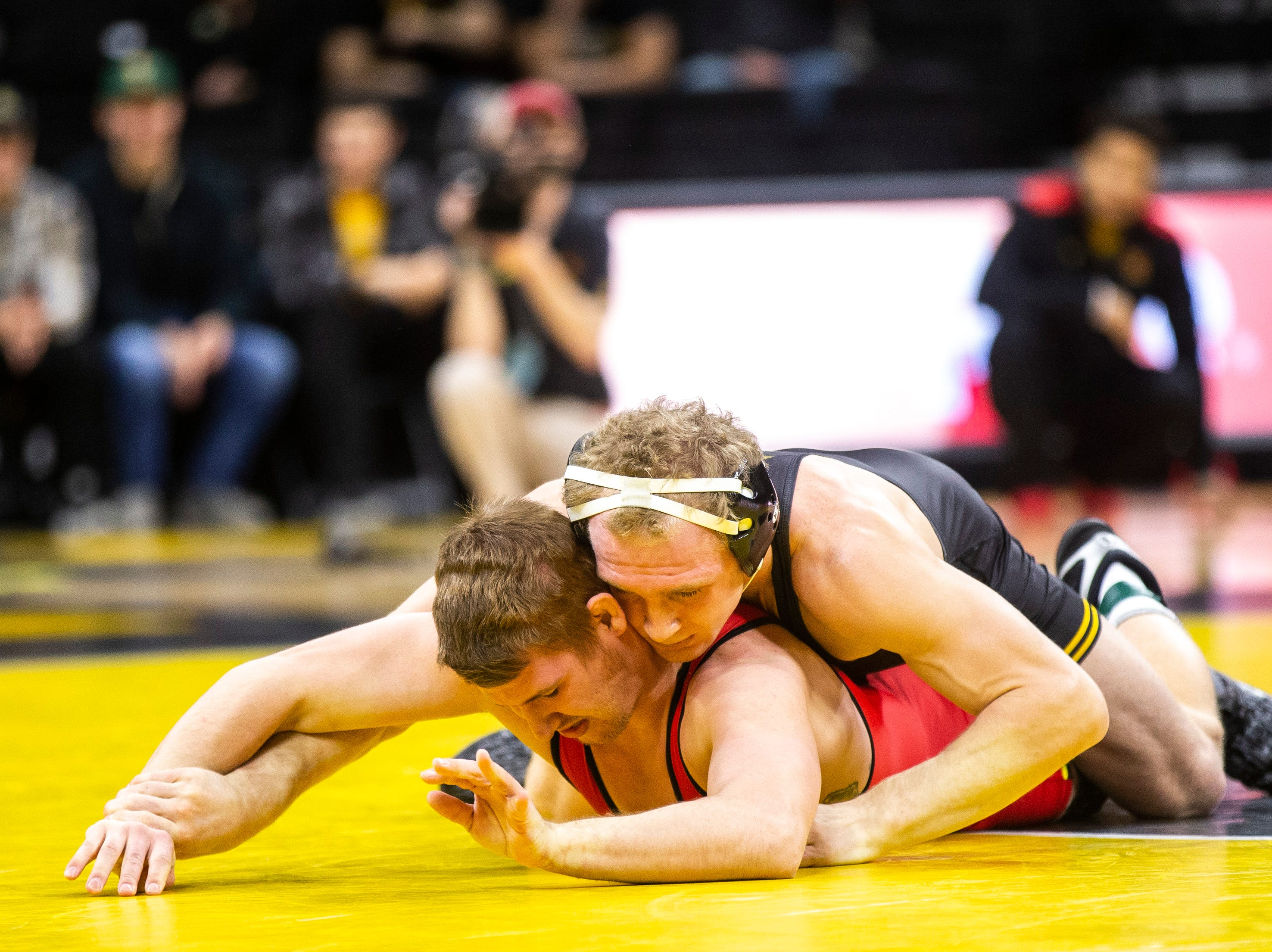 Iowa's Kaleb Young, right, wrestles Maryland's Ryan Diehl at 157 during a NCAA Big Ten Conference wrestling dual on Friday, Feb. 8, 2019 at Carver-Hawkeye Arena in Iowa City, Iowa.