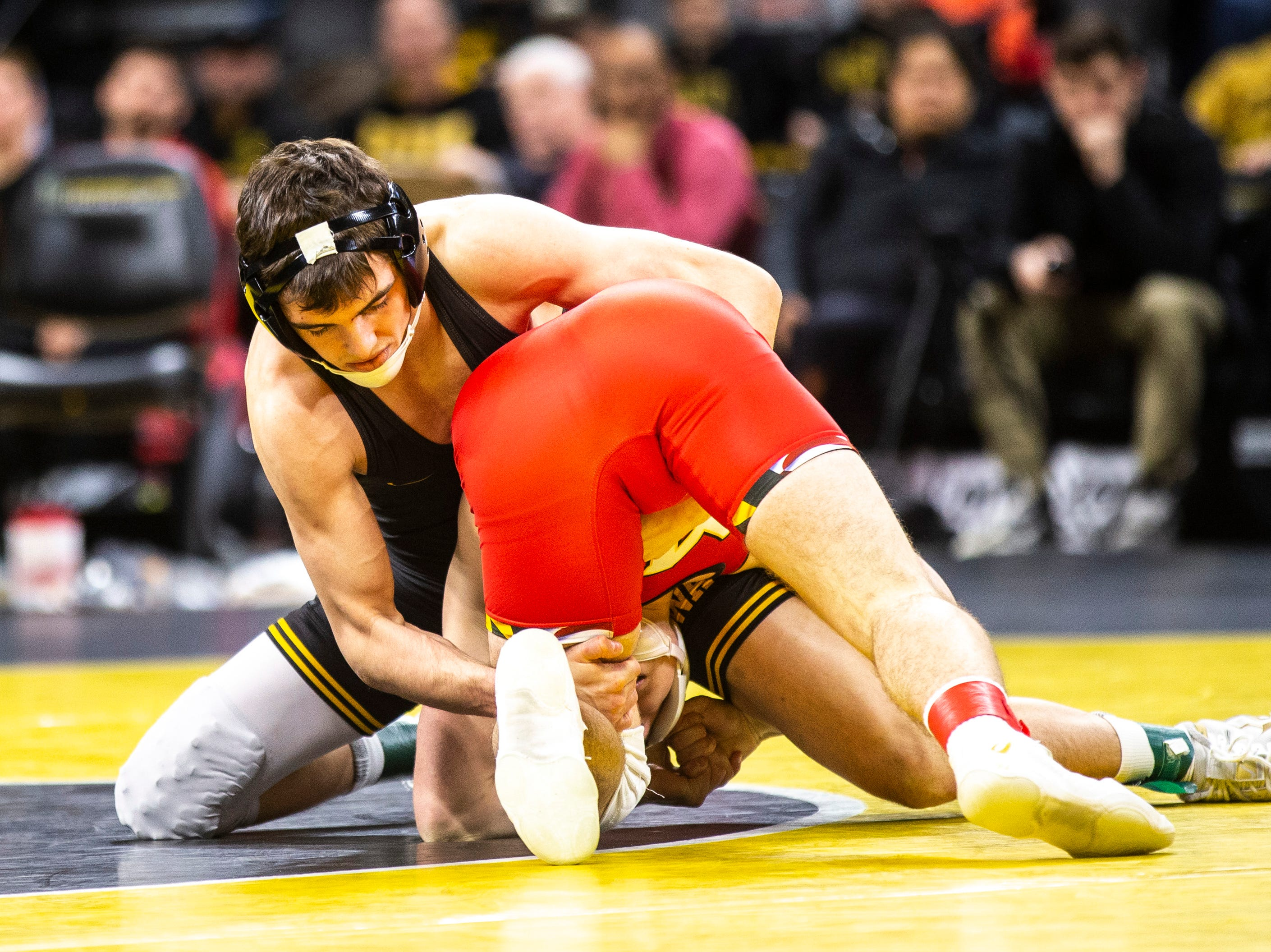 Iowa's Paul Glynn, left, wrestles Maryland's Orion Anderson at 133 during a NCAA Big Ten Conference wrestling dual on Friday, Feb. 8, 2019 at Carver-Hawkeye Arena in Iowa City, Iowa.