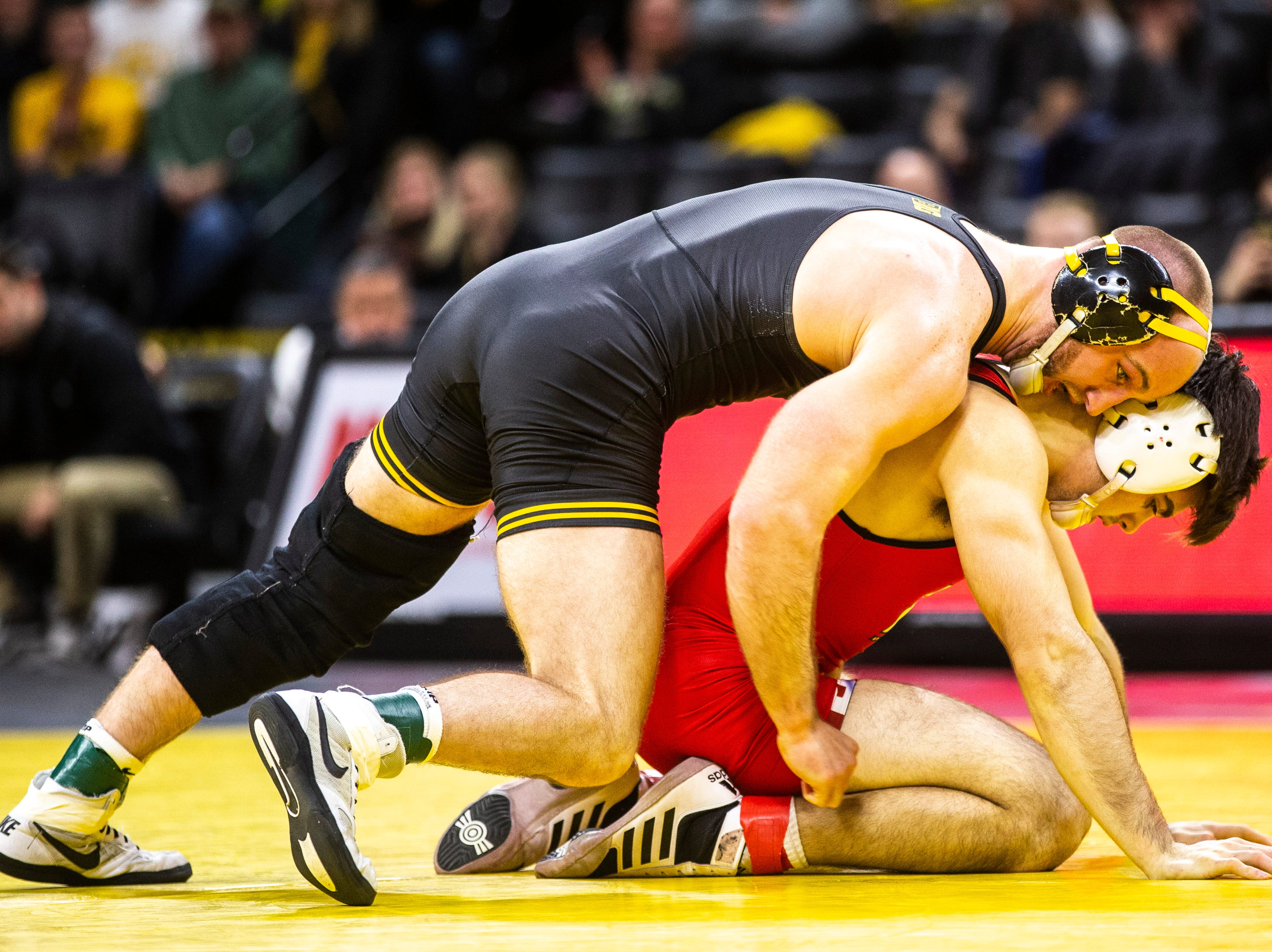 Iowa's Alex Marinelli, top, wrestles Maryland's Philip Spadafora at 165 during a NCAA Big Ten Conference wrestling dual on Friday, Feb. 8, 2019 at Carver-Hawkeye Arena in Iowa City, Iowa.